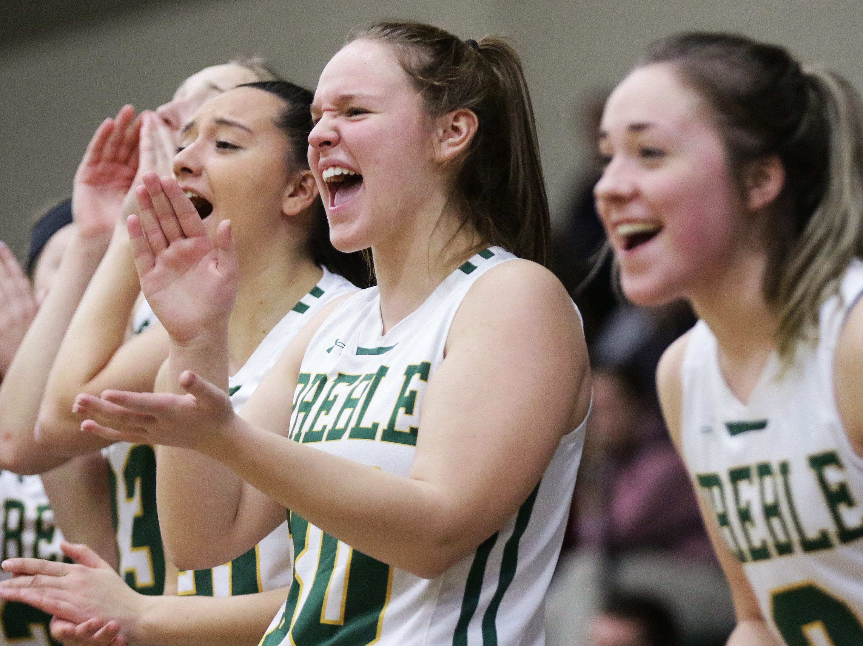 Green Bay Preble players celebrate from the bench during a girls basketball game against De Pere at Preble high school on Tuesday, January 8, 2019 in Green Bay, Wis.