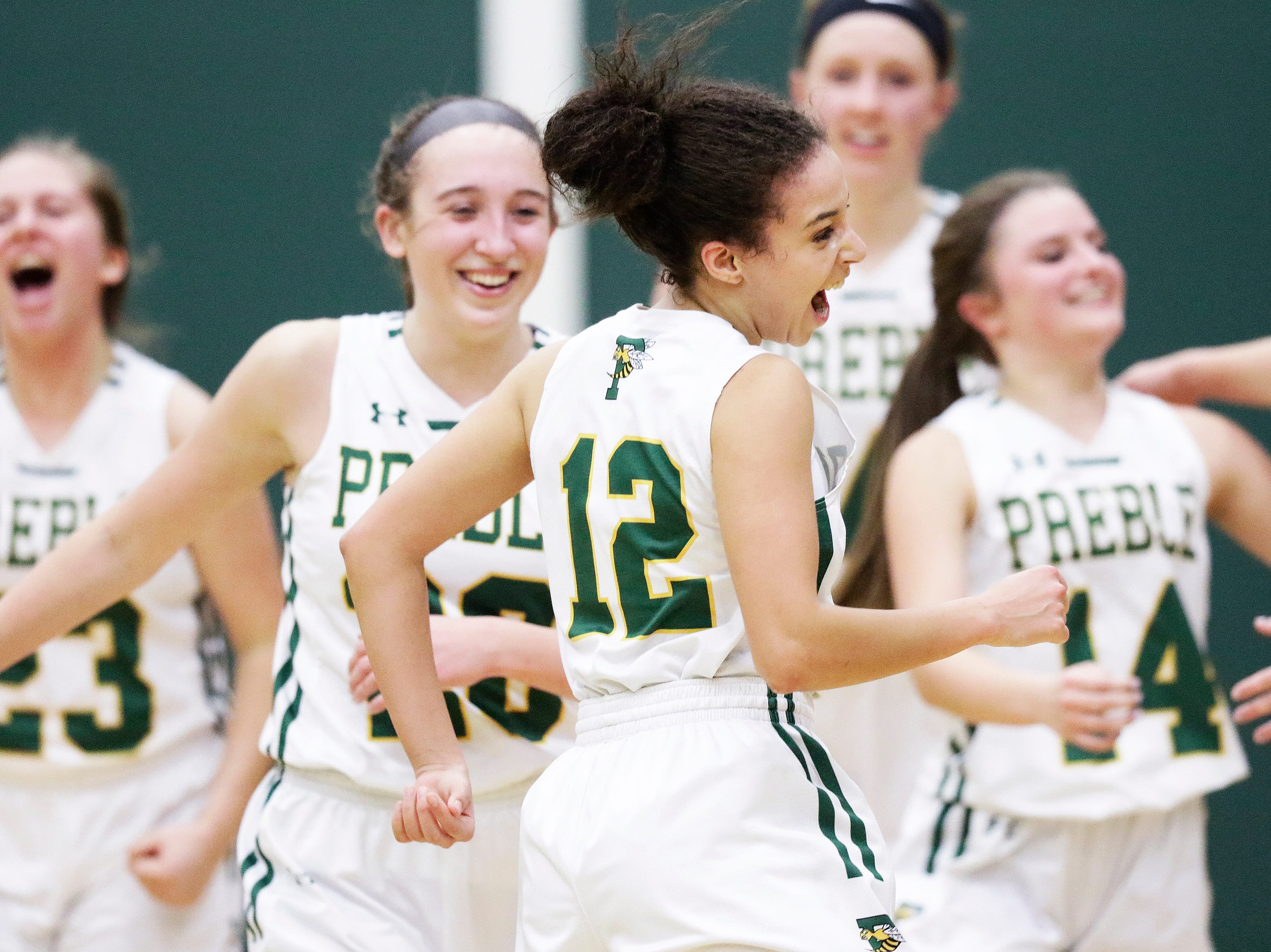 Green Bay Preble's Hannah Beauchamp (12) celebrates after the Hornets defeated De Pere in a girls basketball game at Preble high school on Tuesday, January 8, 2019 in Green Bay, Wis.