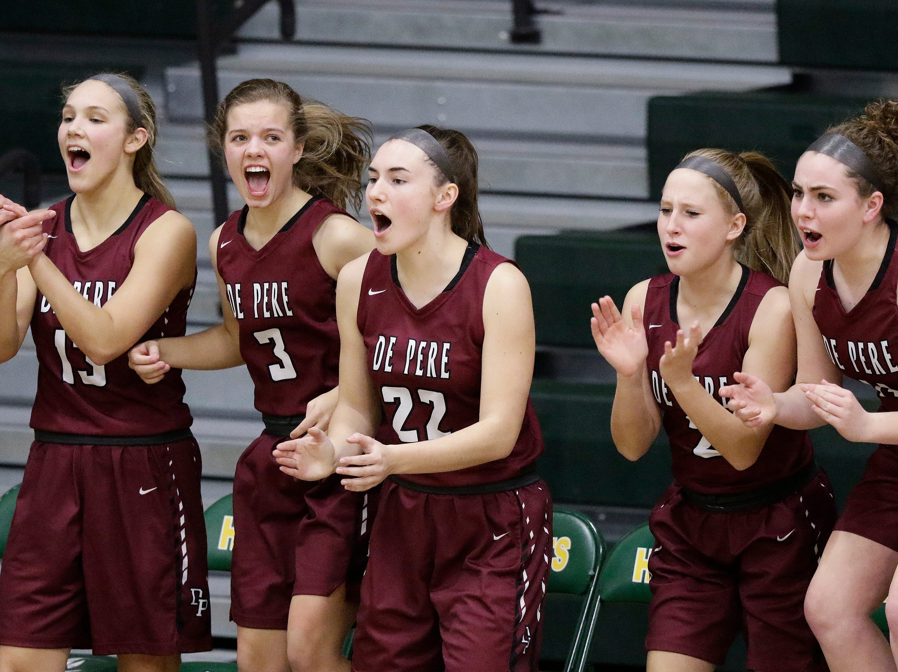 De Pere players cheer from the bench during a girls basketball game against Green Bay Preble at Preble high school on Tuesday, January 8, 2019 in Green Bay, Wis.