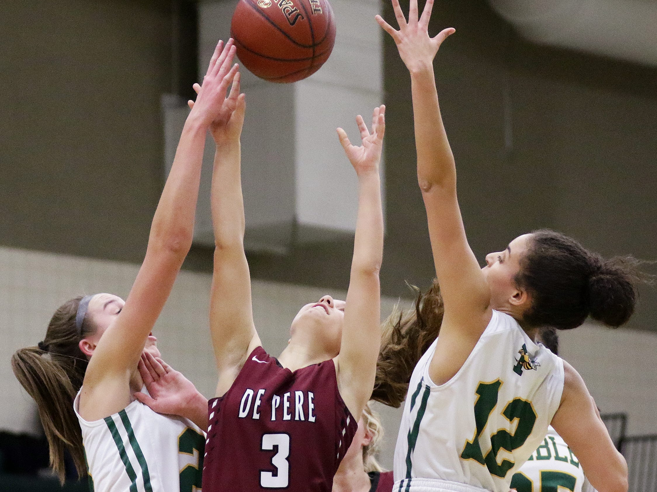 De Pere's Sophie Hubbard (3) has a shot blocked by Green Bay Preble's Carley Duffney (20) in a girls basketball game at Preble high school on Tuesday, January 8, 2019 in Green Bay, Wis.