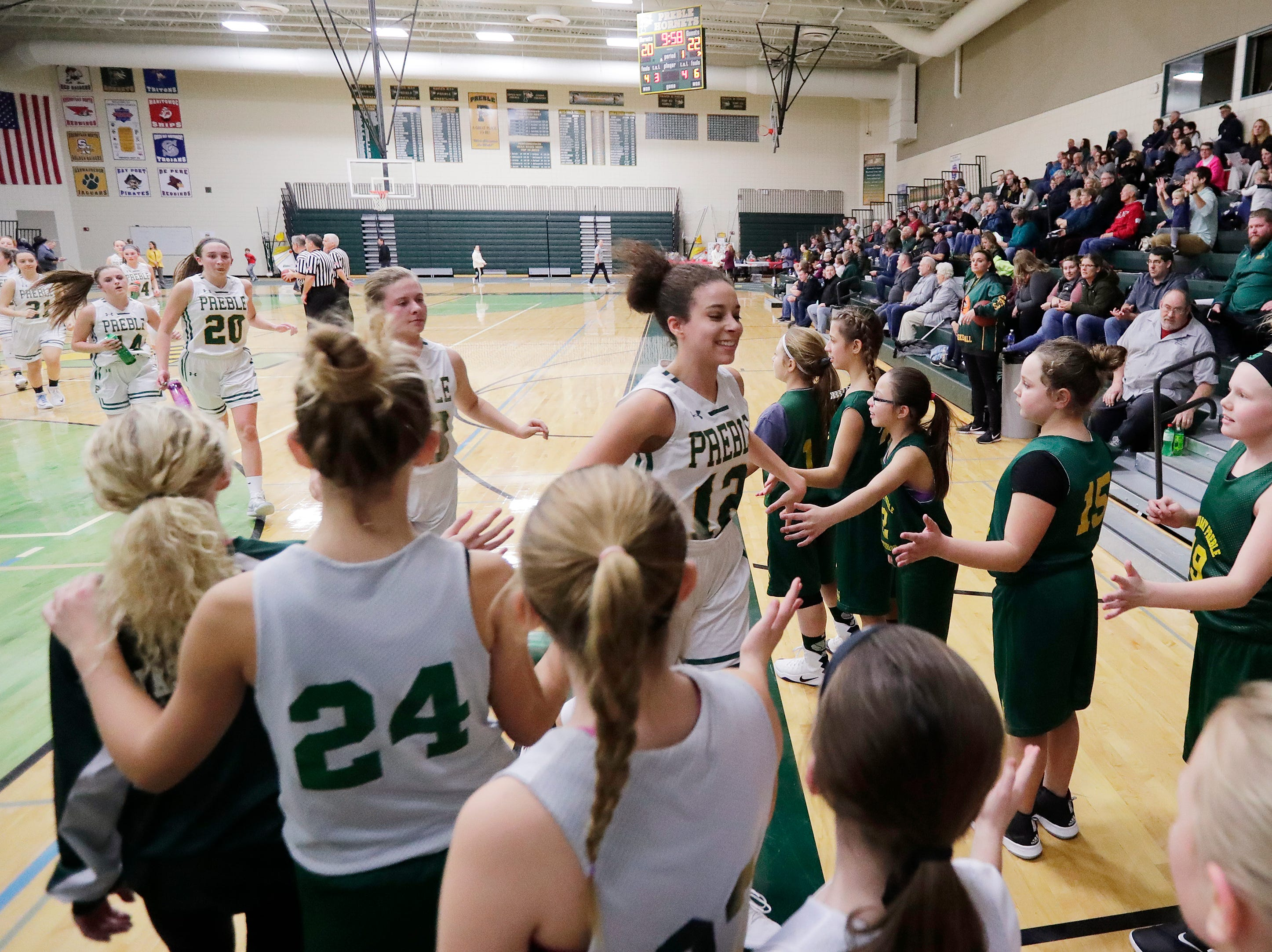 Green Bay Preble players leave the court at half time against De Pere in a girls basketball game at Preble high school on Tuesday, January 8, 2019 in Green Bay, Wis.