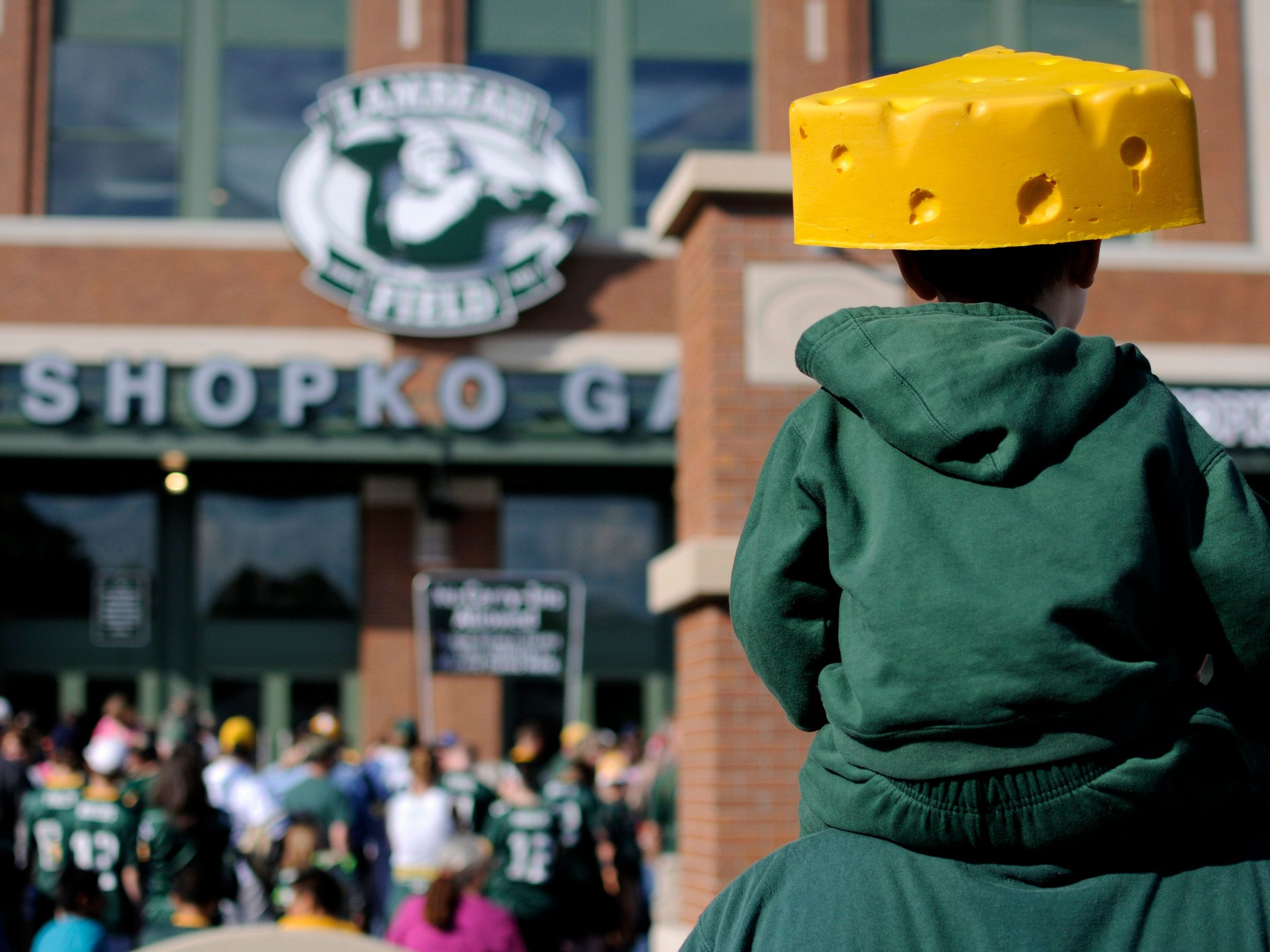 A young cheesehead waits to enter the new Shopko Gate before Packers Family Night at Lambeau Field on Aug. 3, 2013.