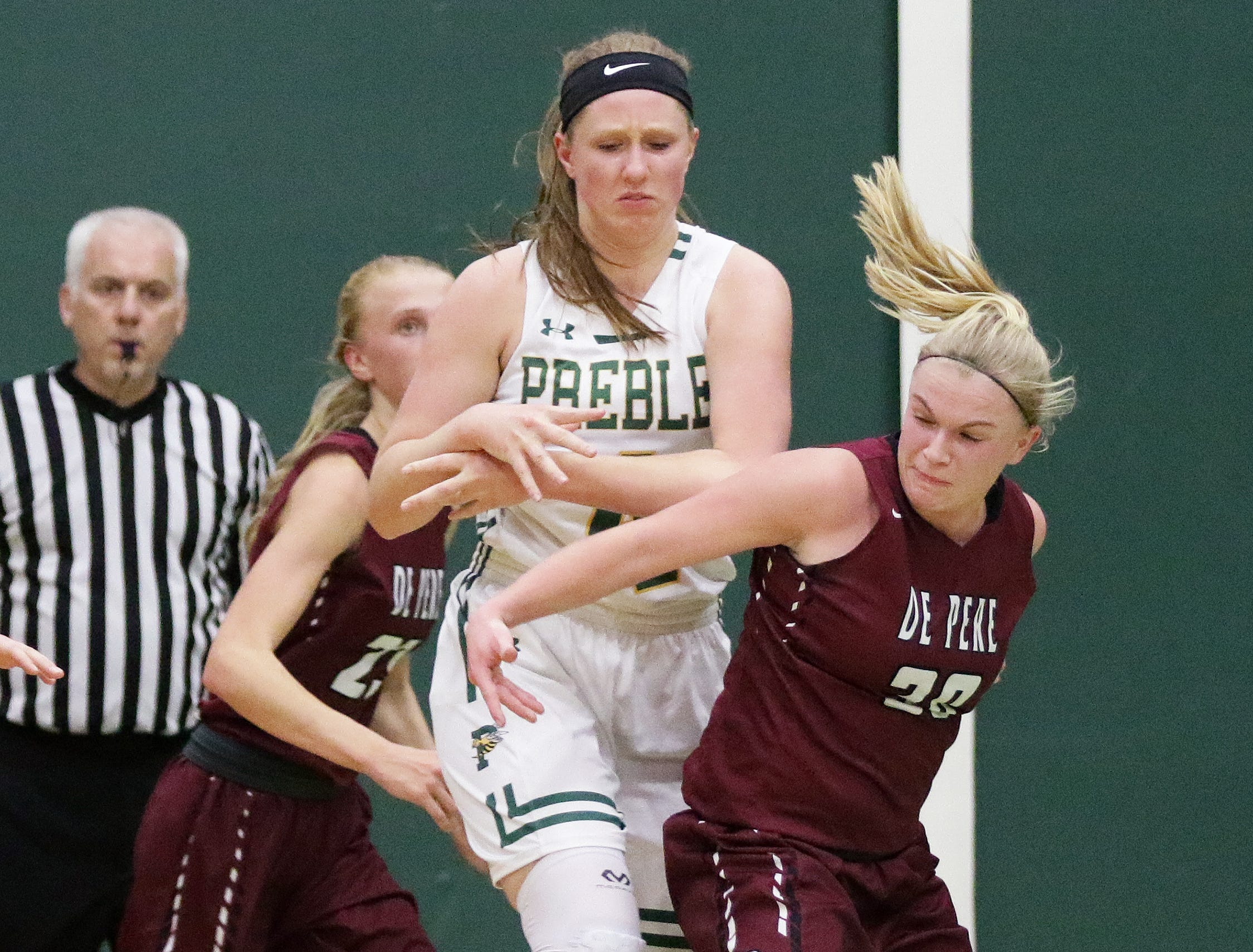 De Pere's Rachel Kerkhoff (30) steals the ball from Green Bay Preble's Kendall Renard (4) in a girls basketball game at Preble high school on Tuesday, January 8, 2019 in Green Bay, Wis.