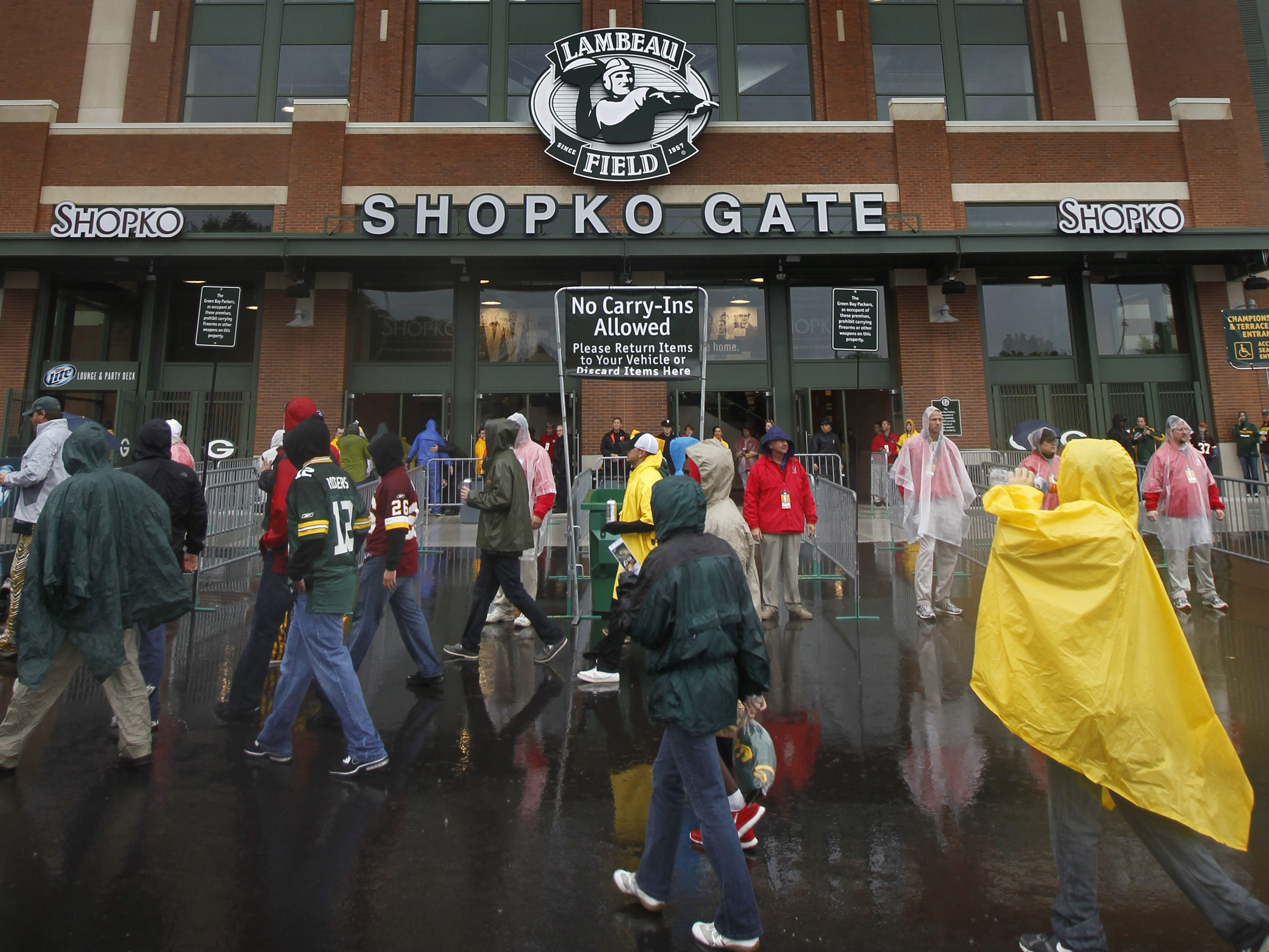 Fans enter the new Shopko gate before the Green Bay Packers played the Washington Redskins at Lambeau Field on September 15, 2013. Shopko has sponsored the gate since the Lambeau Field renovation was completed earlier that year.