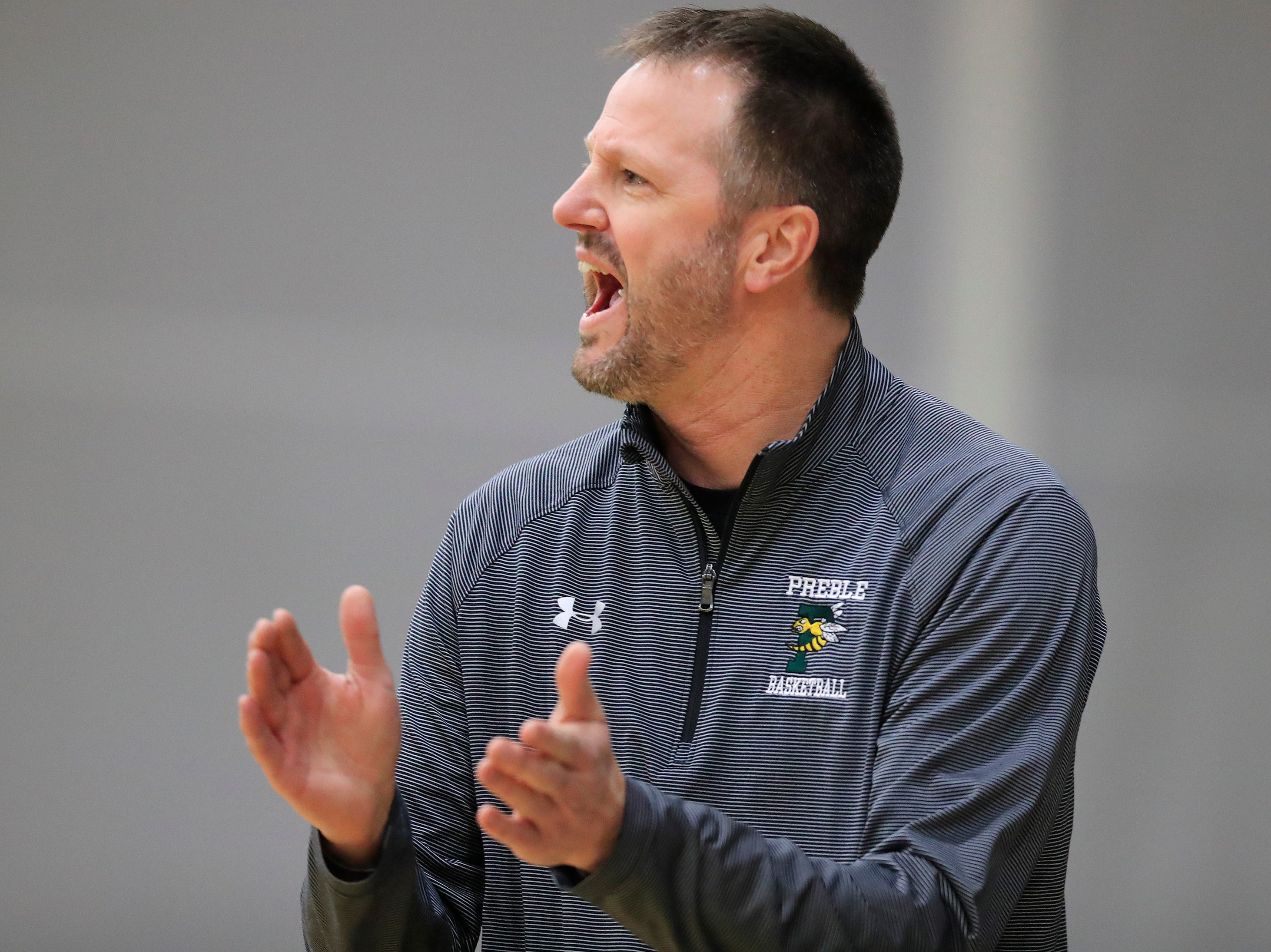 Green Bay Preble head coach Jim Doell reacts on the sideline during in a girls basketball game against De Pere at Preble high school on Tuesday, January 8, 2019 in Green Bay, Wis.