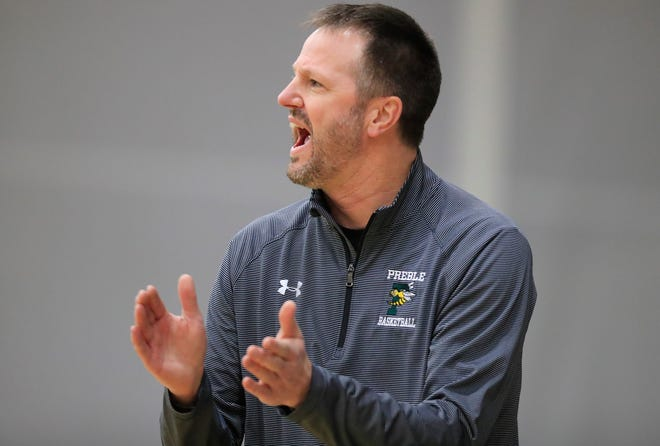 Green Bay Preble coach Jim Doell reacts on the sideline during a game against De Pere earlier this month.
