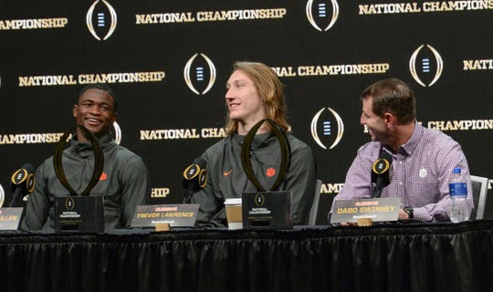 Clemson cornerback Trayvon Mullen, left, quarterback Trevor Lawrence, middle, and Head Coach Dabo Swinney, right, speak to media the day after the College Football Championship in San Jose, California Tuesday, January 8, 2019.