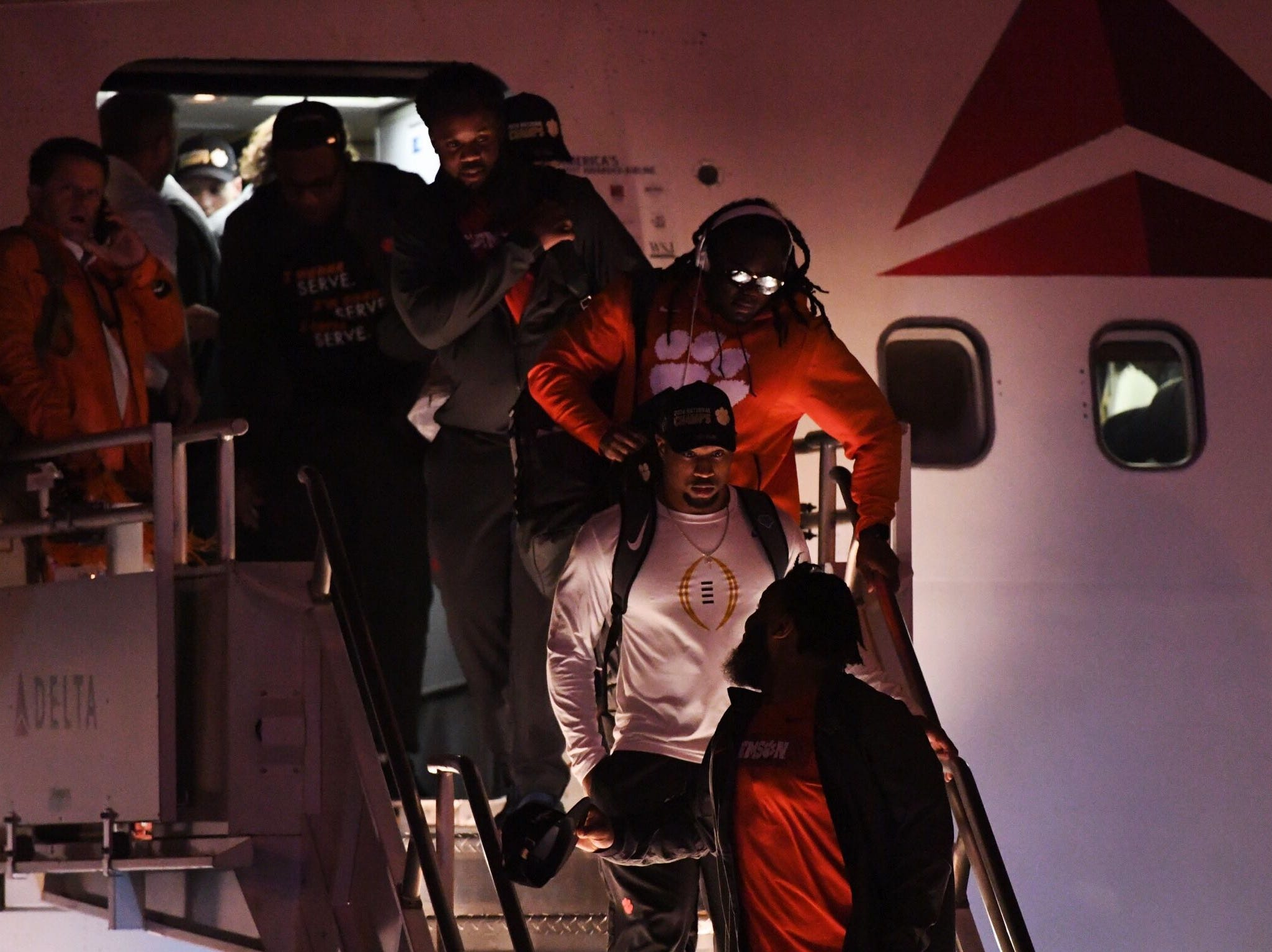 Clemson players and coaches arrive back in South Carolina after defeating Alabama in the National Championship game in Santa Clara, California.