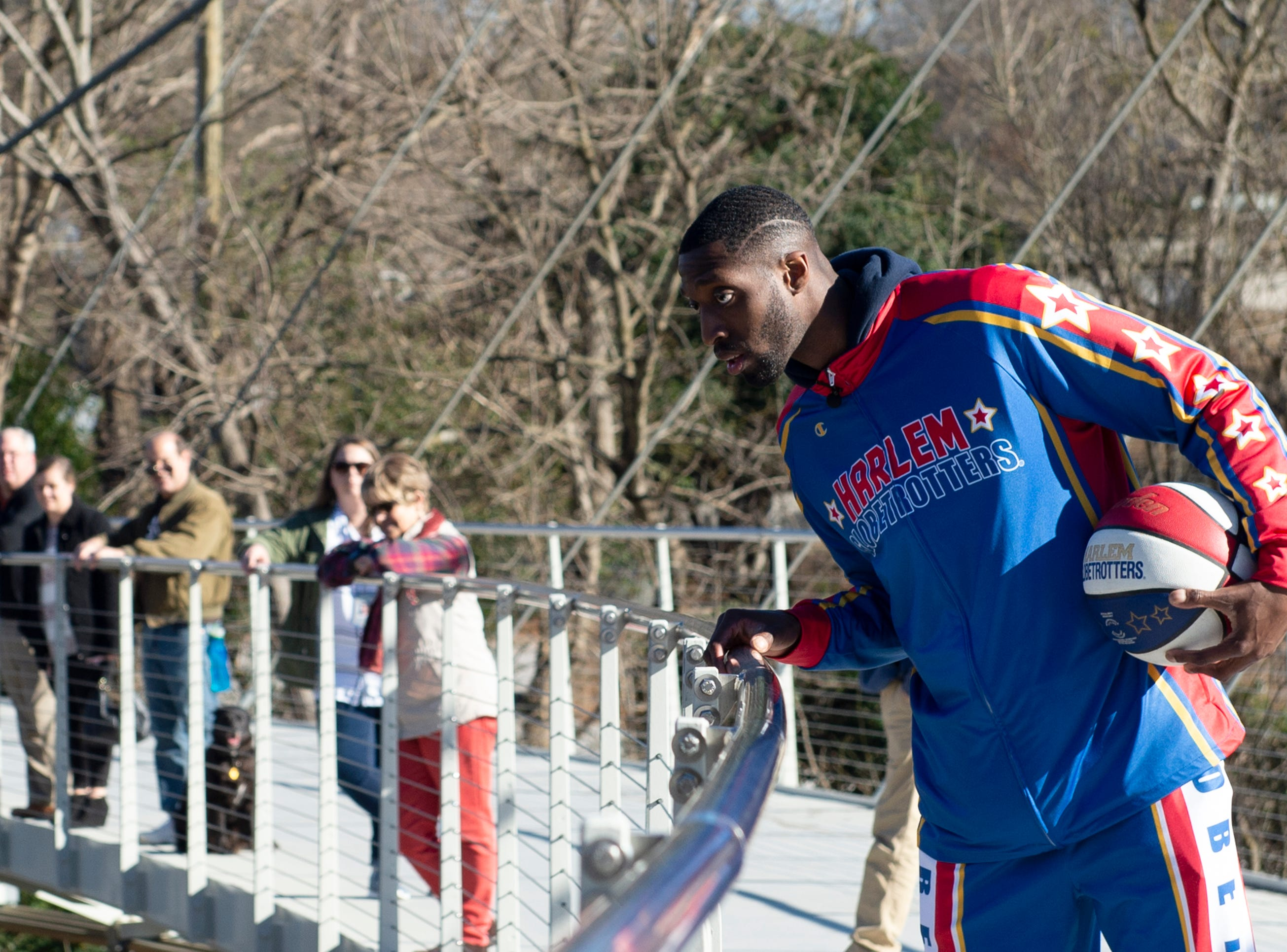 "Harlem Globetrotter Chandler ""Bulldog"" Mack tries to make a basket off of the Liberty Bridge at Falls Park on the Reedy  while filming a promotional video Wednesday, Jan. 9, 2019."