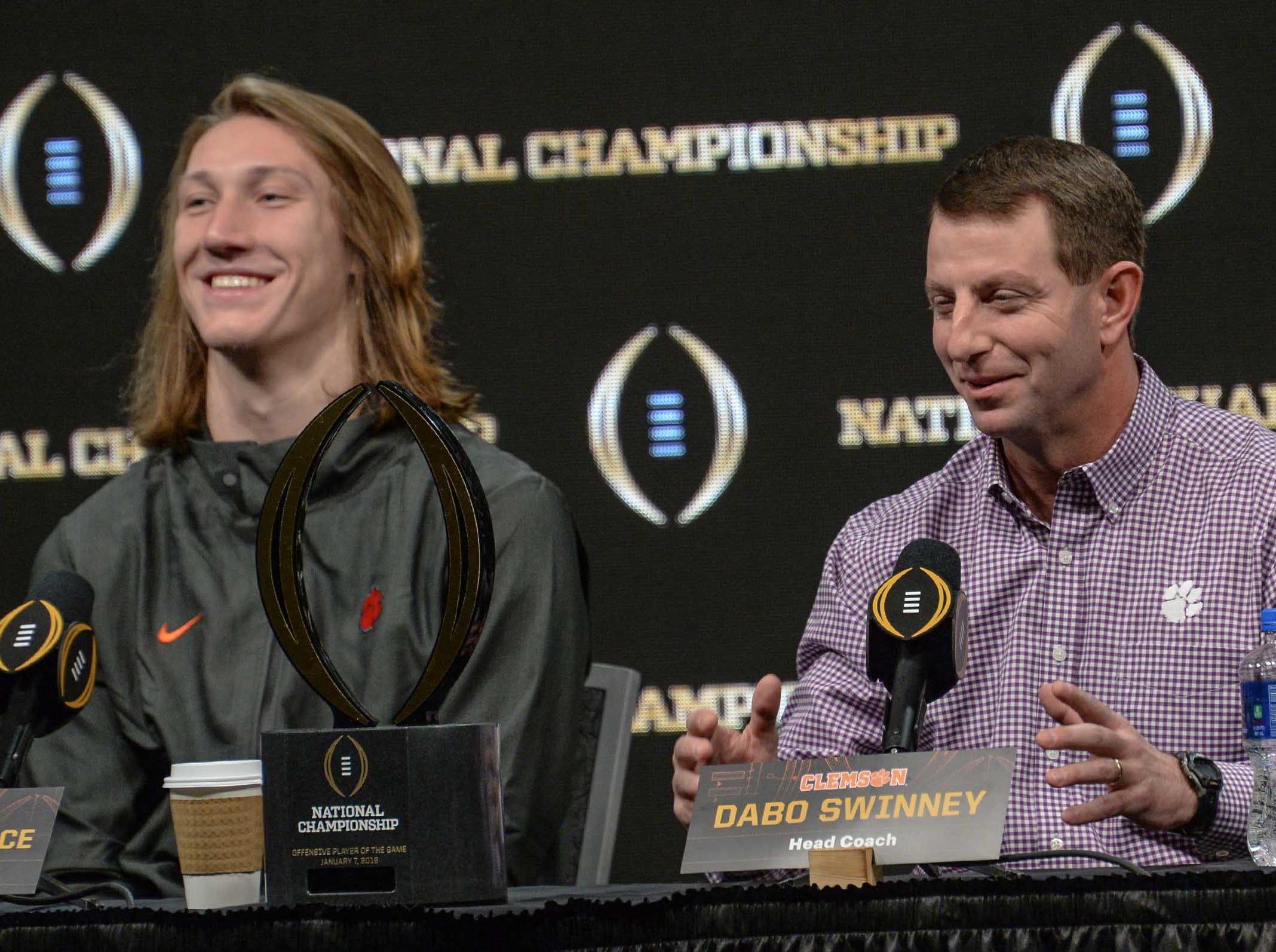 Clemson Head Coach Dabo Swinney, right, speaks to media near offensive most valuable player quarterback Trevor Lawrence, left, during the champions press conference the day after the College Football Championship in San Jose, California Tuesday, January 8, 2019.