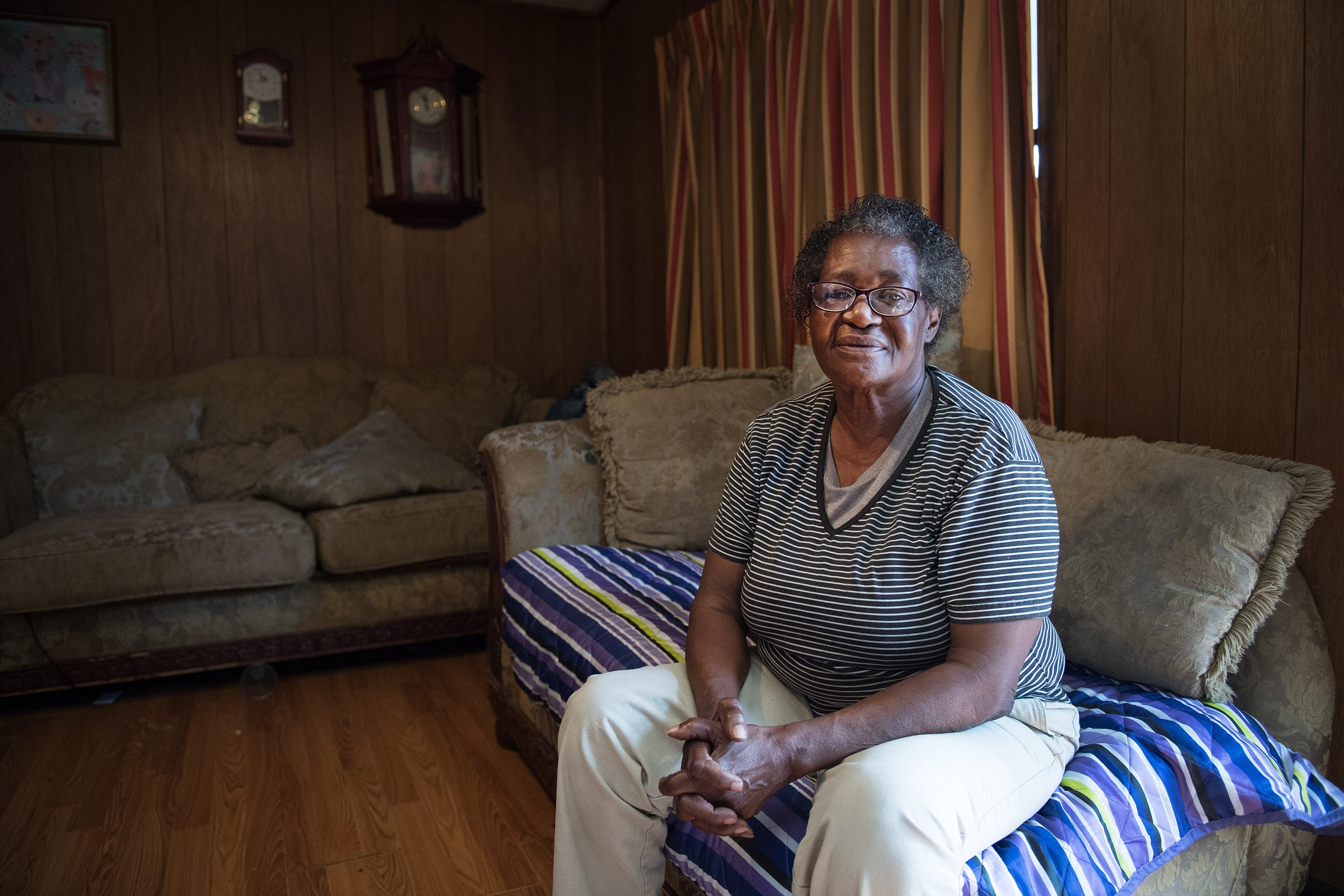 Ella Bromell sits in her home in Conway on Feb. 21, 2018. These days, she rarely leaves her yard — she said she lives in fear of losing her 1,000-square-foot home. She's endured years of efforts by the city of Conway to seize her house, an attempt to shut down drug dealers by going after Bromell.