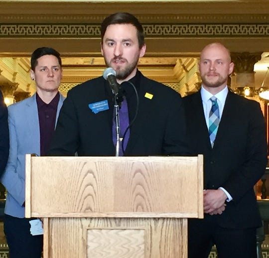 Rep. Casey Knudsen, R-Malta, center, speaks in January about House Bill 217 as SK Rossi of the ACLU and David Herbst of Americans For Prosperity look on.