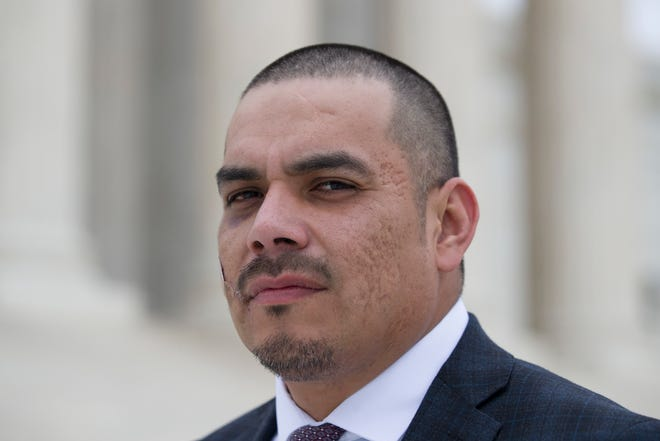 Clayvin Herrera poses for a picture on the plaza of the Supreme Court, Tuesday, Jan. 8, 2019, in Washington. The U.S. Supreme is reviewing a case in which Clayvin Herrera, a Crow tribal member and former tribal game warden from Montana, is asserting his right under a 150-year-old treaty with the U.S. government to hunt elk in the Bighorn National Forest in Wyoming. (AP Photo/Alex Brandon)