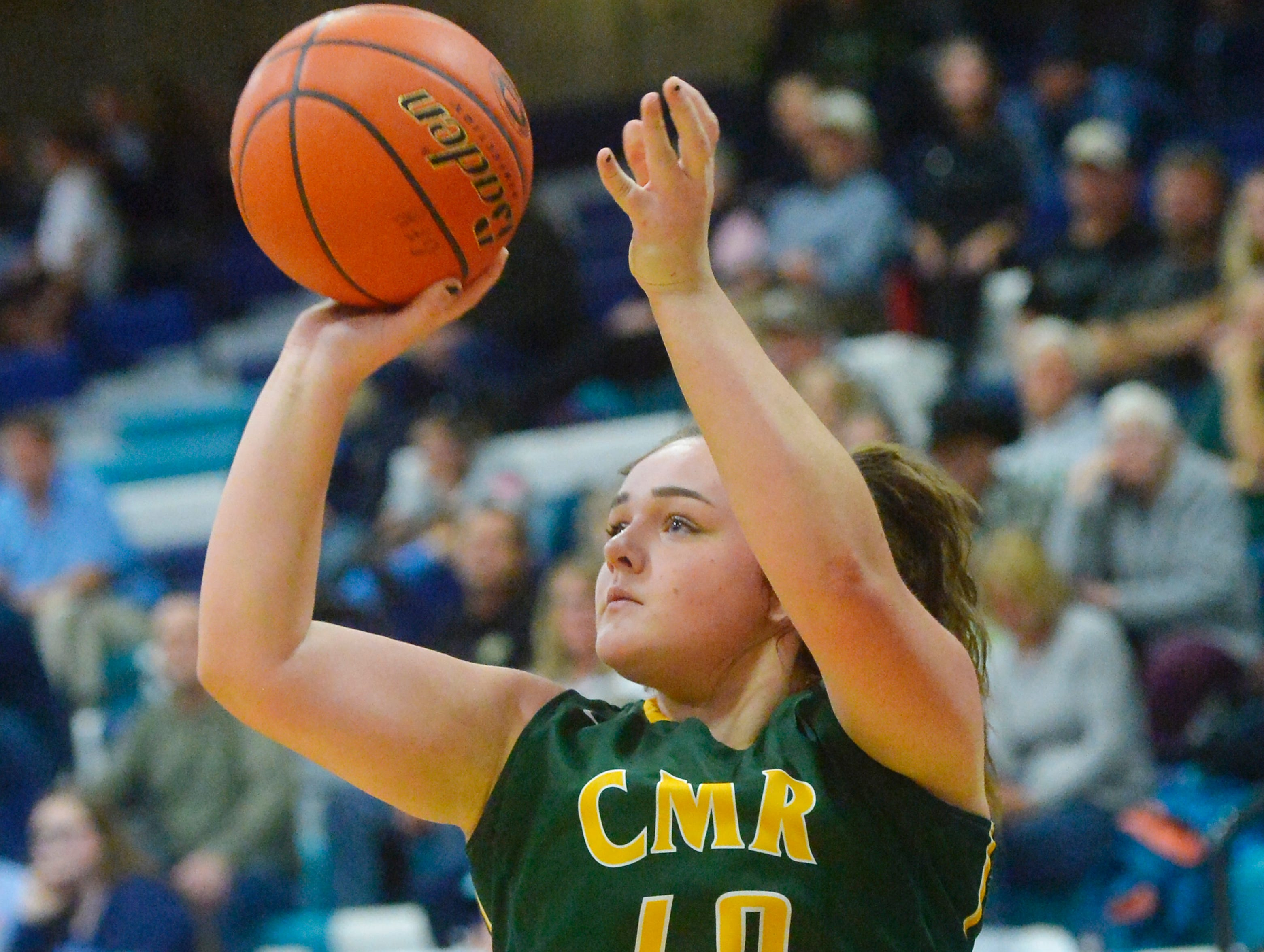 CMR's Marley Calliham shoots from the outside during the crosstown basketball game, Tuesday night in the Swarthout Fieldhouse.