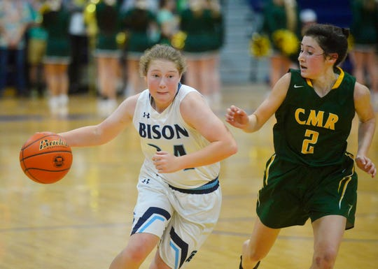 Ryen Palmer of Great Falls High drives to the basket last winter against C.M. Russell High's Lauren Lindseth. Palmer and stepsister Morgan Sunchild are two of many fine Bison softball players who will take the field against the Rustlers on Tuesday afternoon.