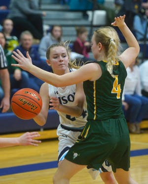 Great Falls High's Gracie Lins makes a pass while defended by CMR's Chloe Pace in the first crosstown meeting earlier this season. The teams meet again Thursday night at 7:30 at CMR Fieldhouse.