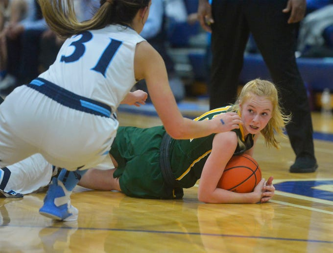 CMR's Emily Funseth corrals a loose ball during Tuesday's crosstown basketball game against Great Falls High.