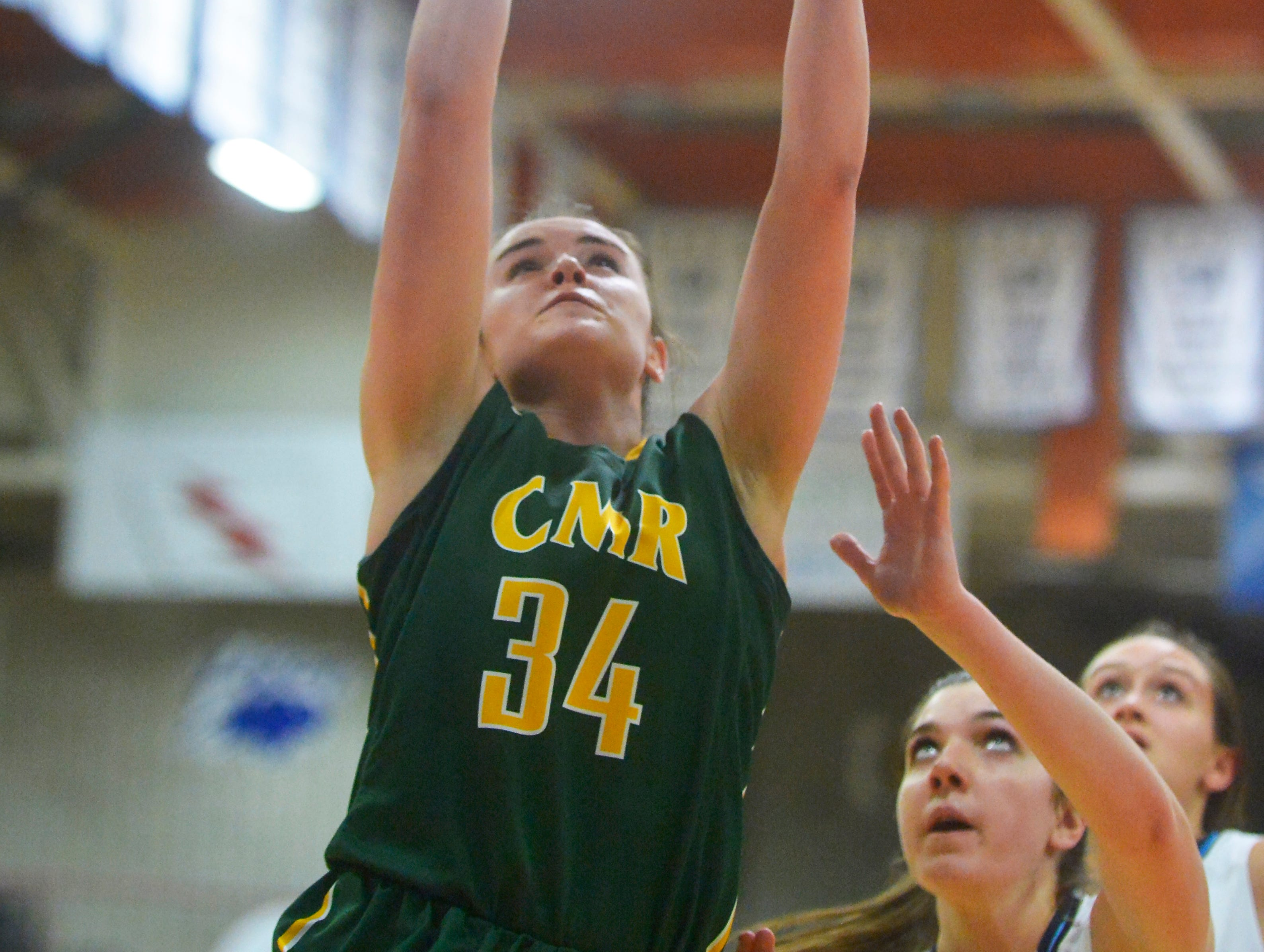 CMR's Kiely Gunderson attempts a layup during the crosstown basketball game, Tuesday night in the Swarthout Fieldhouse.