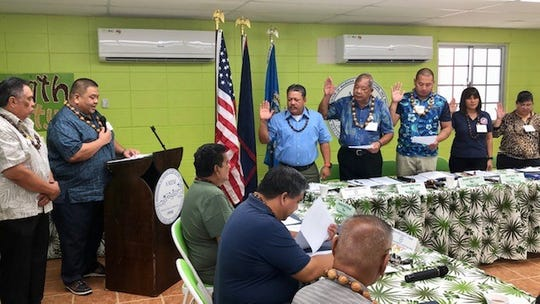 Outgoing Tinian Mayor Joey Patrick San Nicolas administers the oath of office to the 2019-2020 officers of the Association of Mariana Islands' Mayors and Vice Mayors on Jan. 9, 2019 at the Agat Community Center, with Agat Mayor Kevin Susuico as the new president and Saipan Mayor David Apatang as the new vice president.