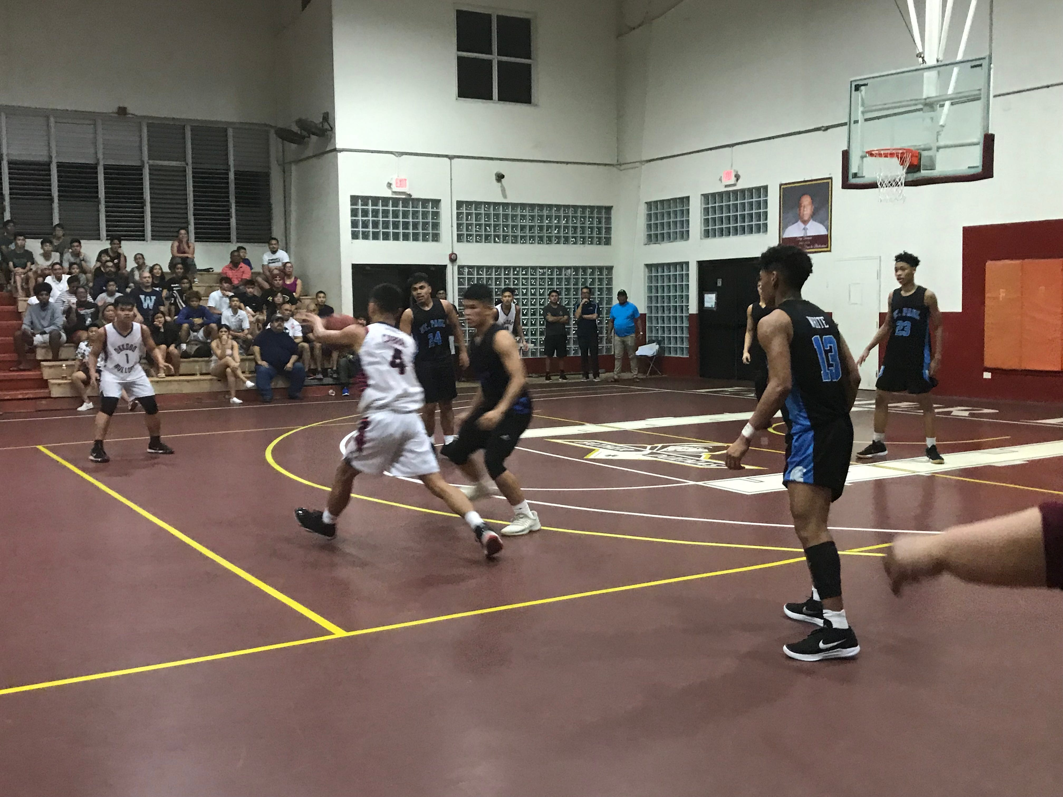 The St. Paul Warriors took on the Okkodo Bulldogs Tuesday night in the 2019 GSPN Boys' Preseason Basketball Tournament held at the Father Duenas Jungle gym. The Warriors won 81-66 to advance to the final game on Friday.