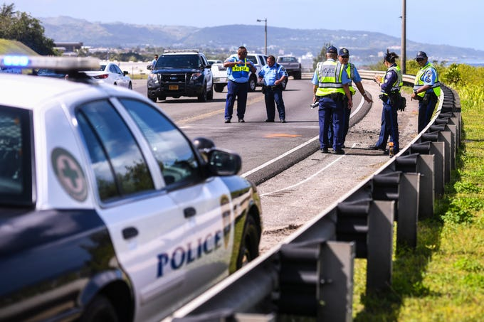 Guam Police Department Highway Patrol Division officers coordinate their efforts on Wednesday, Jan. 9, as they map out the scene of a two-car collision that occurred on Route 10A on Sunday, Jan. 6. An adult male involved in the crash was transported to the Guam Memorial Hospital, according to the Guam Fire Department.