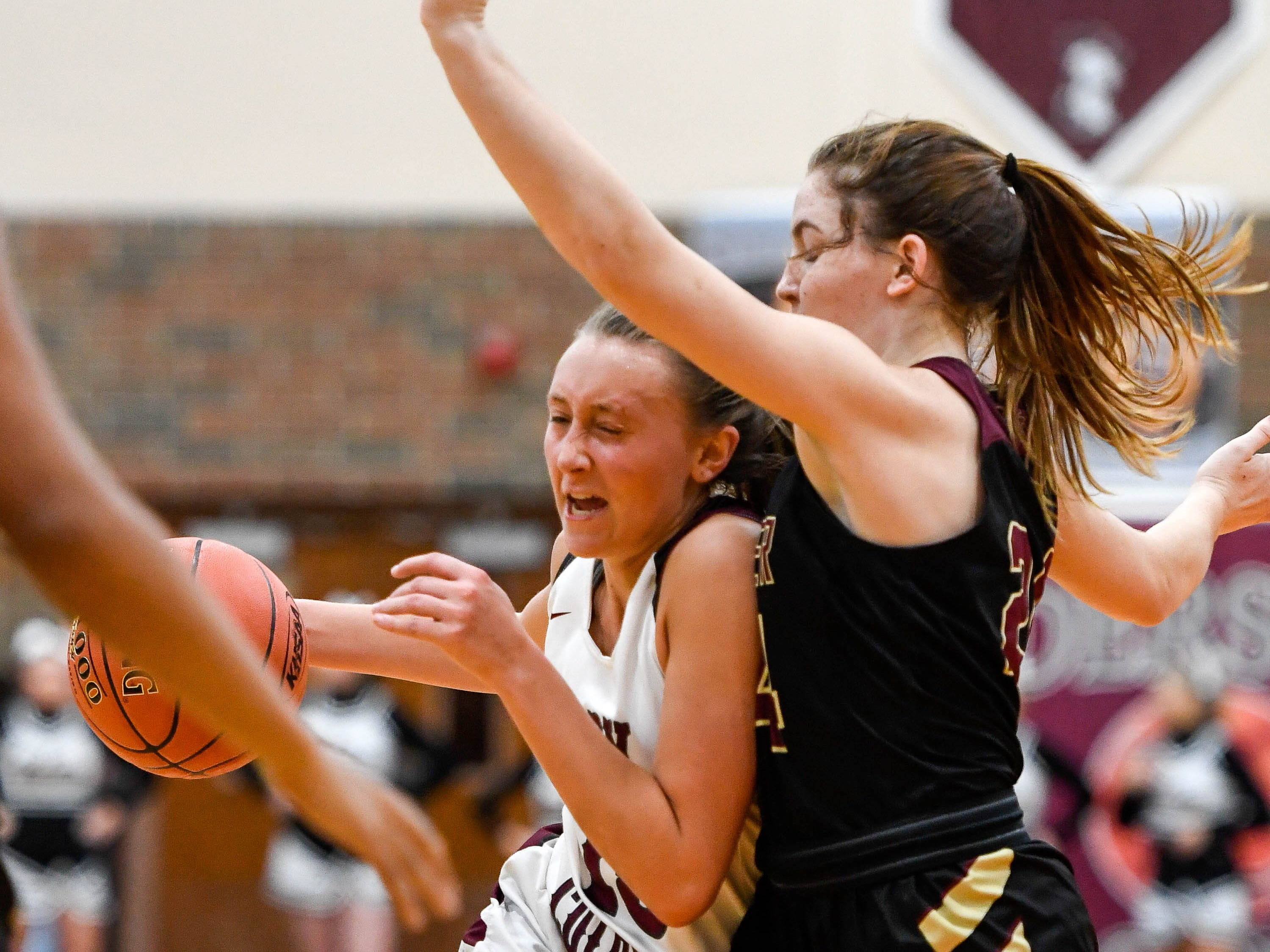 Henderson County's Alyssa Dickson (15) drives to the basket against Webster County's Adeline McDyer (24) as the Henderson County Lady Colonels play 6th district rival the Webster County Lady Trojans at Henderson's Colonel Gym Tuesday, January 8, 2019.