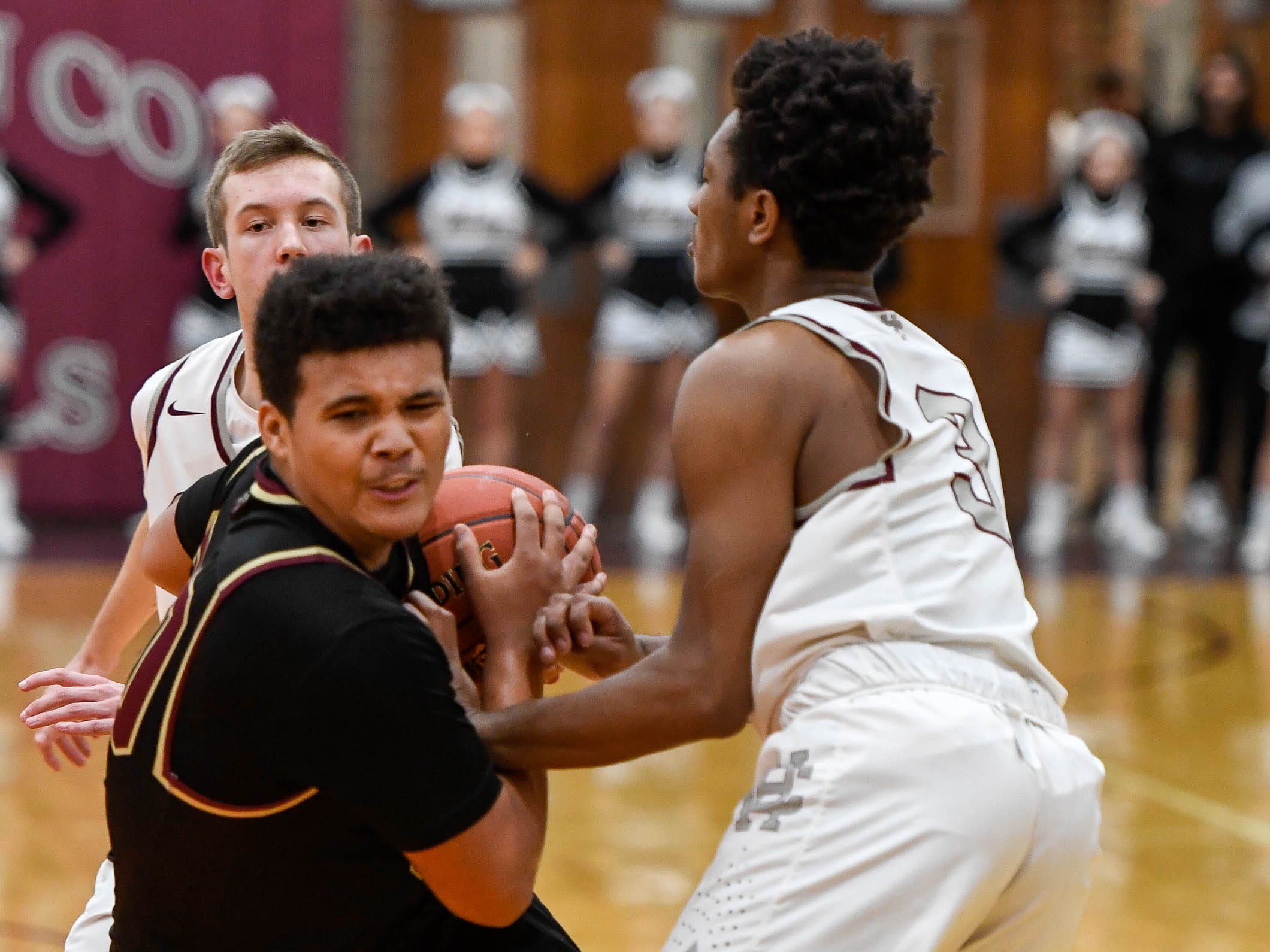 Webster County's Malachi Douglas (30) tries to drive past Henderson's Daymian Dixon (3) as the Henderson County Colonels play 6th district rival the Webster County Trojans at Henderson's Colonel Gym Tuesday, January 8, 2019.