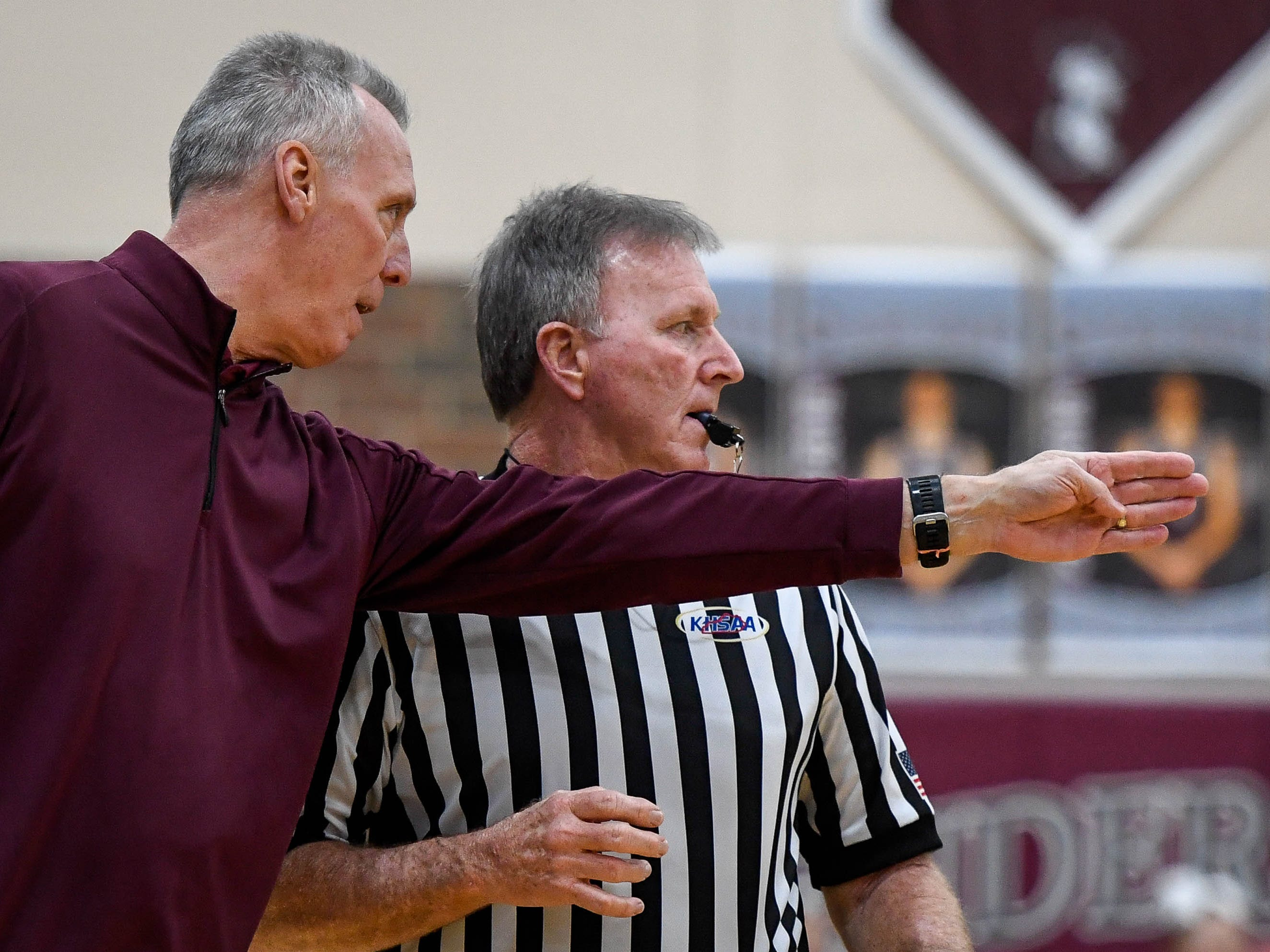 Henderson County Head Coach Jeff Haile bends the referee's ear as the Henderson County Lady Colonels play 6th district rival the Webster County Lady Trojans at Henderson's Colonel Gym Tuesday, January 8, 2019.