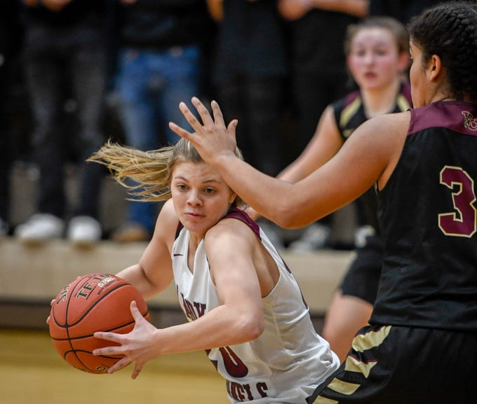 Henderson County's Kaytlan Kemp (20) tuns to shoot as the Henderson County Lady Colonels play 6th district rival the Webster County Lady Trojans at Henderson's Colonel Gym Tuesday, January 8, 2019.