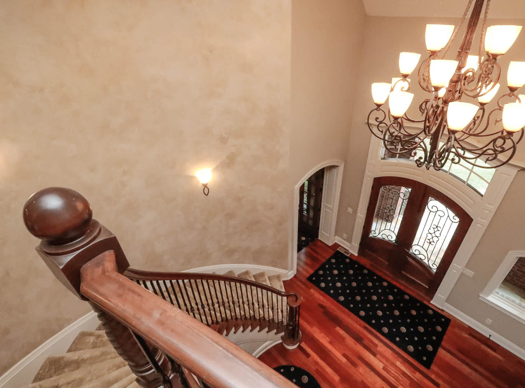 The grand staircase winds up a curving Tuscan painted wall in a traditional style $2m home with elements of French country and Tuscan influence up for sale in Bargersville Ind. on Wednesday, Jan. 9, 2019. The house sits on 8.1 acres.