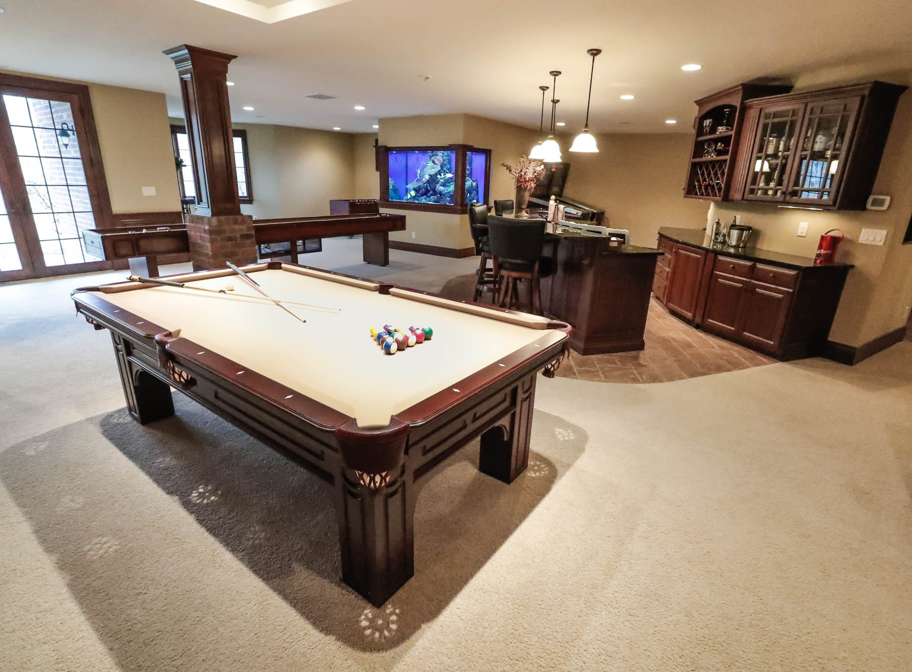 The basement of a traditional $2m home up for sale in Bargersville Ind., features a pool table, shuffleboard table, aquarium, bar, and home theatre room on Wednesday, Jan. 9, 2019. The home sits on 8.1 acres.