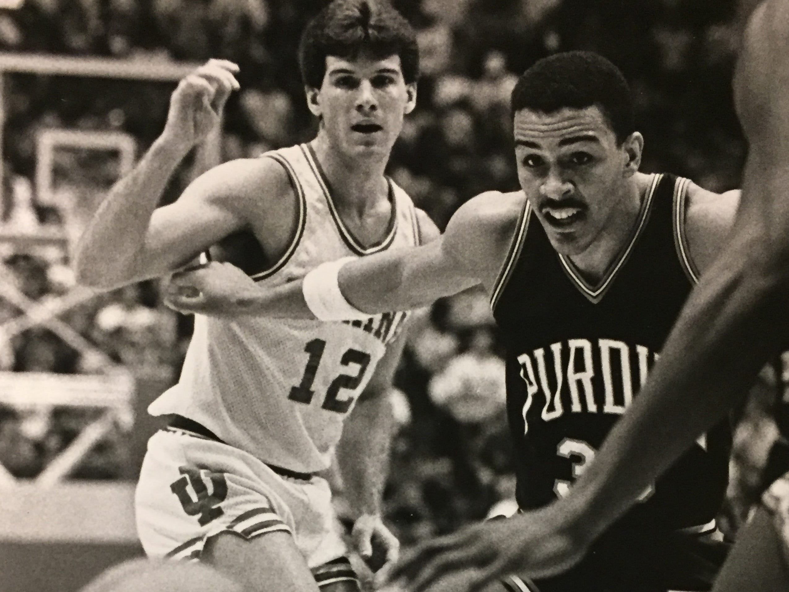 Steve Alford and Purdue's Troy Mitchell watch the ball go out of bounds on Jan. 23, 1986.