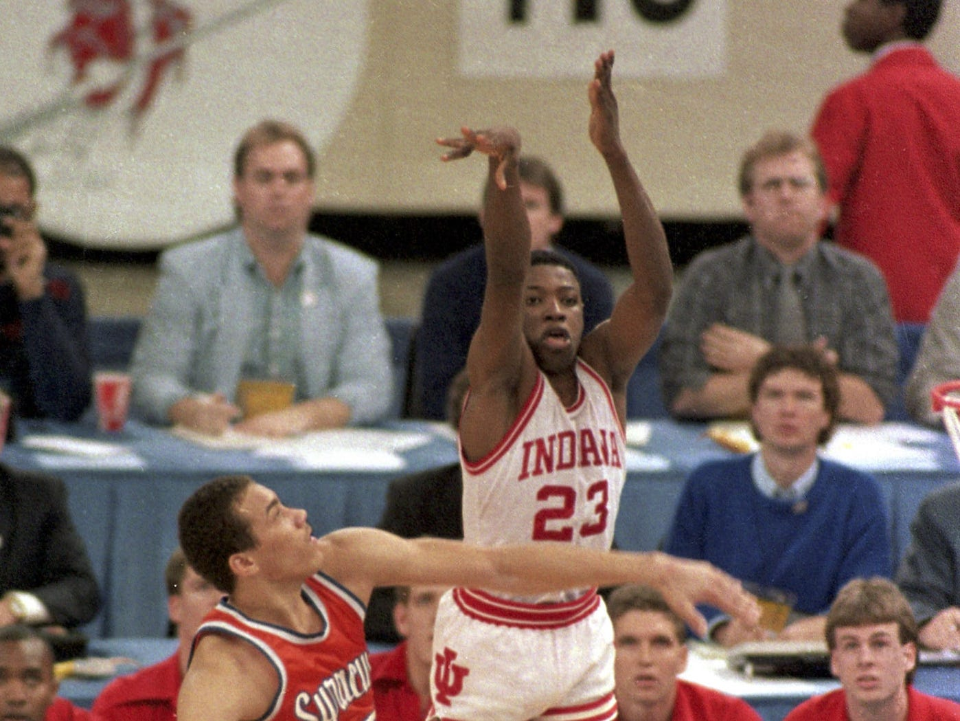 Indiana's Keith Smart (23) fires a shot past Syracuse's Howard Triche for a basket putting Indiana ahead by one point in the final seconds of the NCAA Championship game in New Orleans La. in March 30 1987.