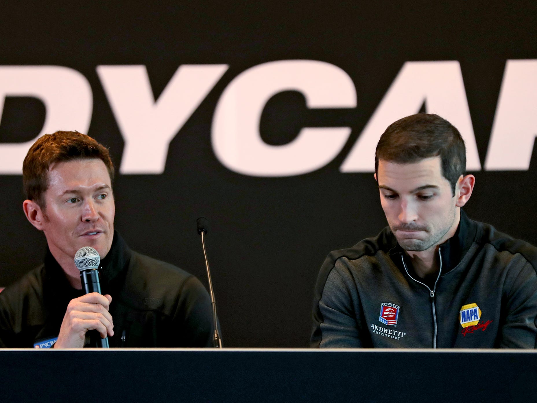 IndyCar racer Scott Dixon, left, speaks as racer Alexander Rossi listens during a press conference on the IndyCar announcement of their TV schedule, during a press conference at Indianapolis Motor Speedway, Wednesday, Jan. 9, 2019.