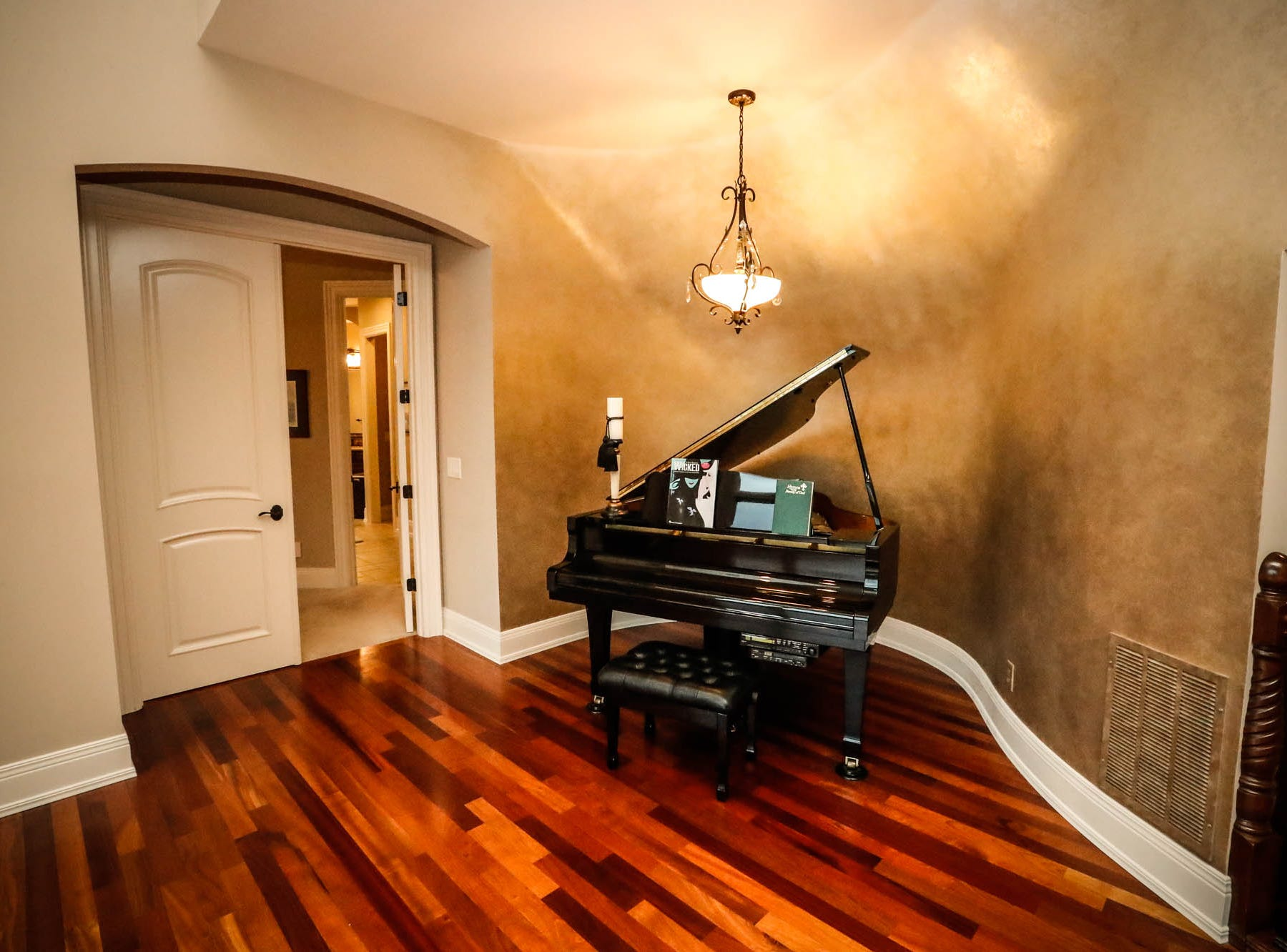 A custom player piano sits in a purpose-built nook in a  traditional $2m home with elements of French country and Tuscan influence up for sale in Bargersville Ind. on Wednesday, Jan. 9, 2019. The house sits on 8.1 acres.