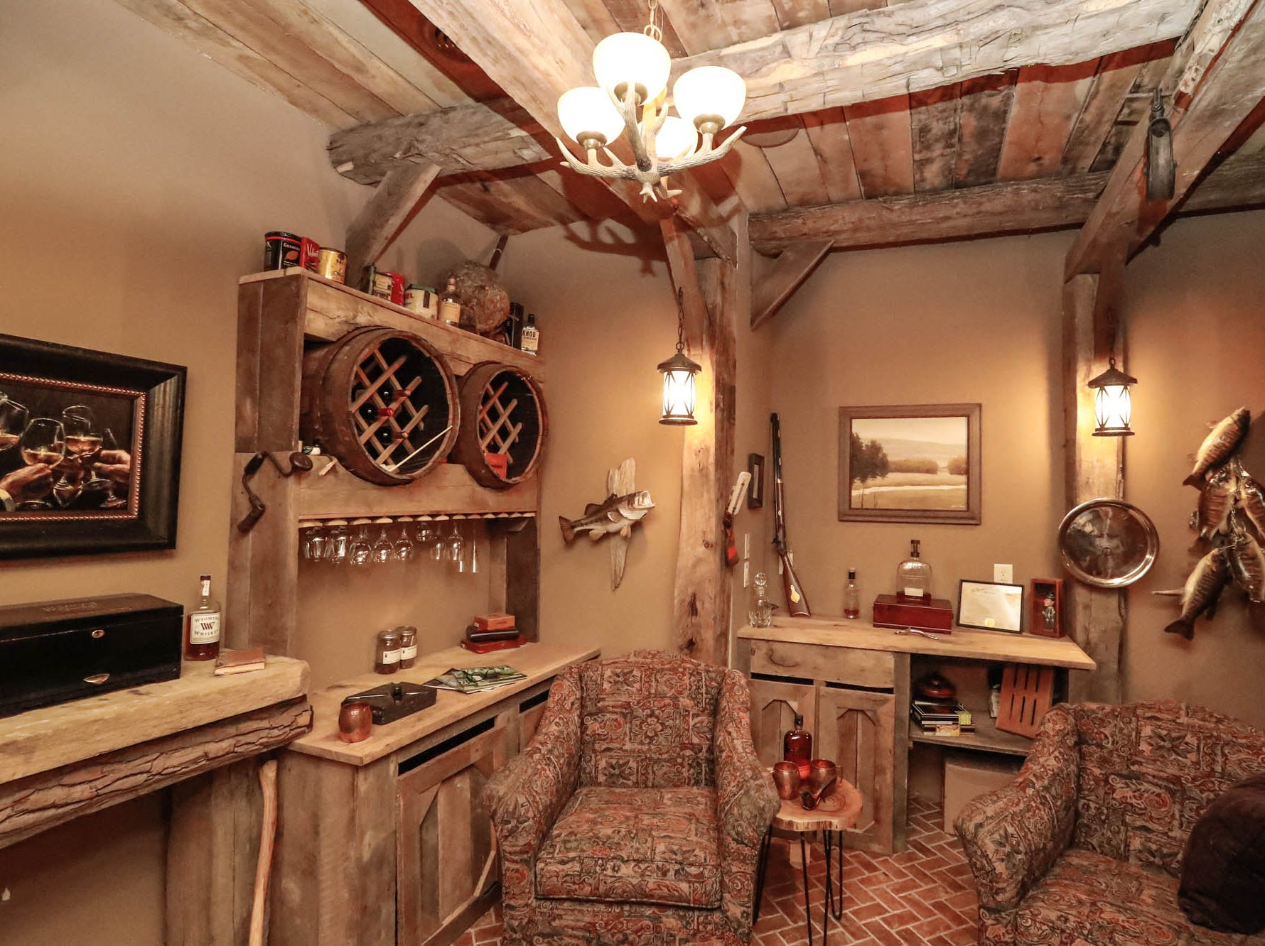 The basement of a traditional $2m home up for sale in Bargersville Ind., features with elements of French country and Tuscan influence including a cigar or wine room with brick flooring and beams from a 100-year-old barn, on Wednesday, Jan. 9, 2019. The home sits on 8.1 acres.