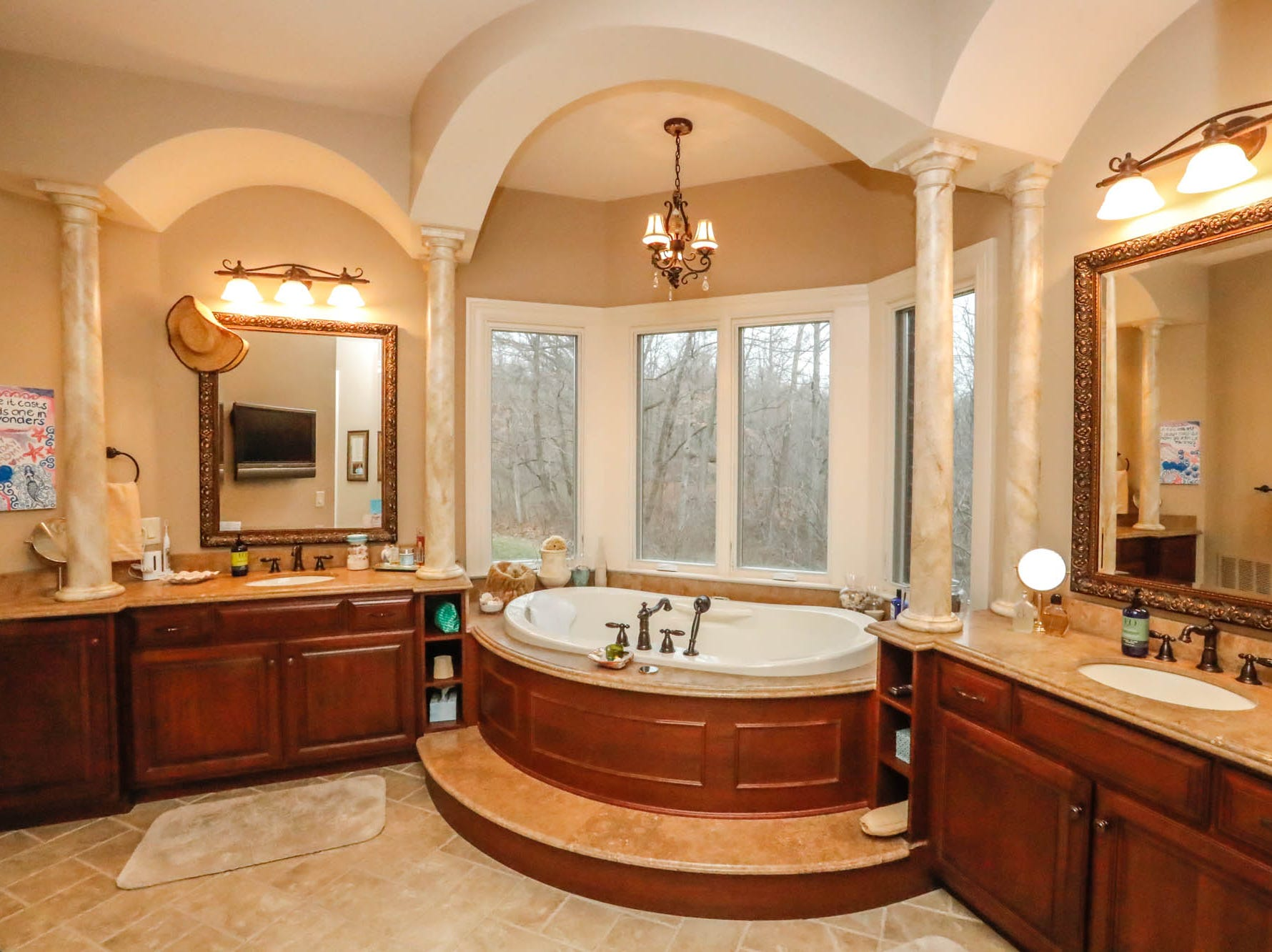 The master bath features double vanities, a soaking tub, and large walk-in shower in a $2 million Bargersville Ind. home up for sale on Wednesday, Jan. 9, 2019. The house sits on 8.1 acres.
