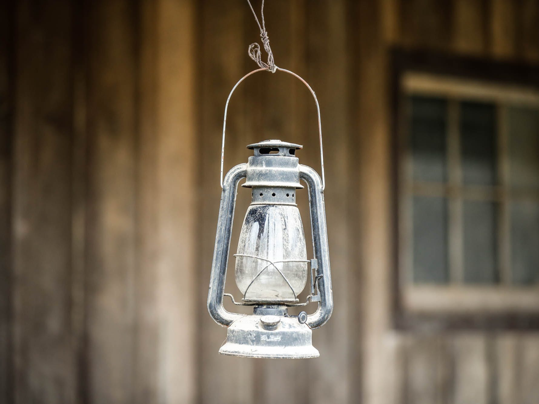 An antique lantern hangs from a one-hundred-year-old barn moved from northern Indiana which sits behind a traditional style $2m home up for sale in Bargersville Ind. on Wednesday, Jan. 9, 2019. The house and barn sit on 8.1 acres and features two horse stalls and a man cave with a vintage stove.