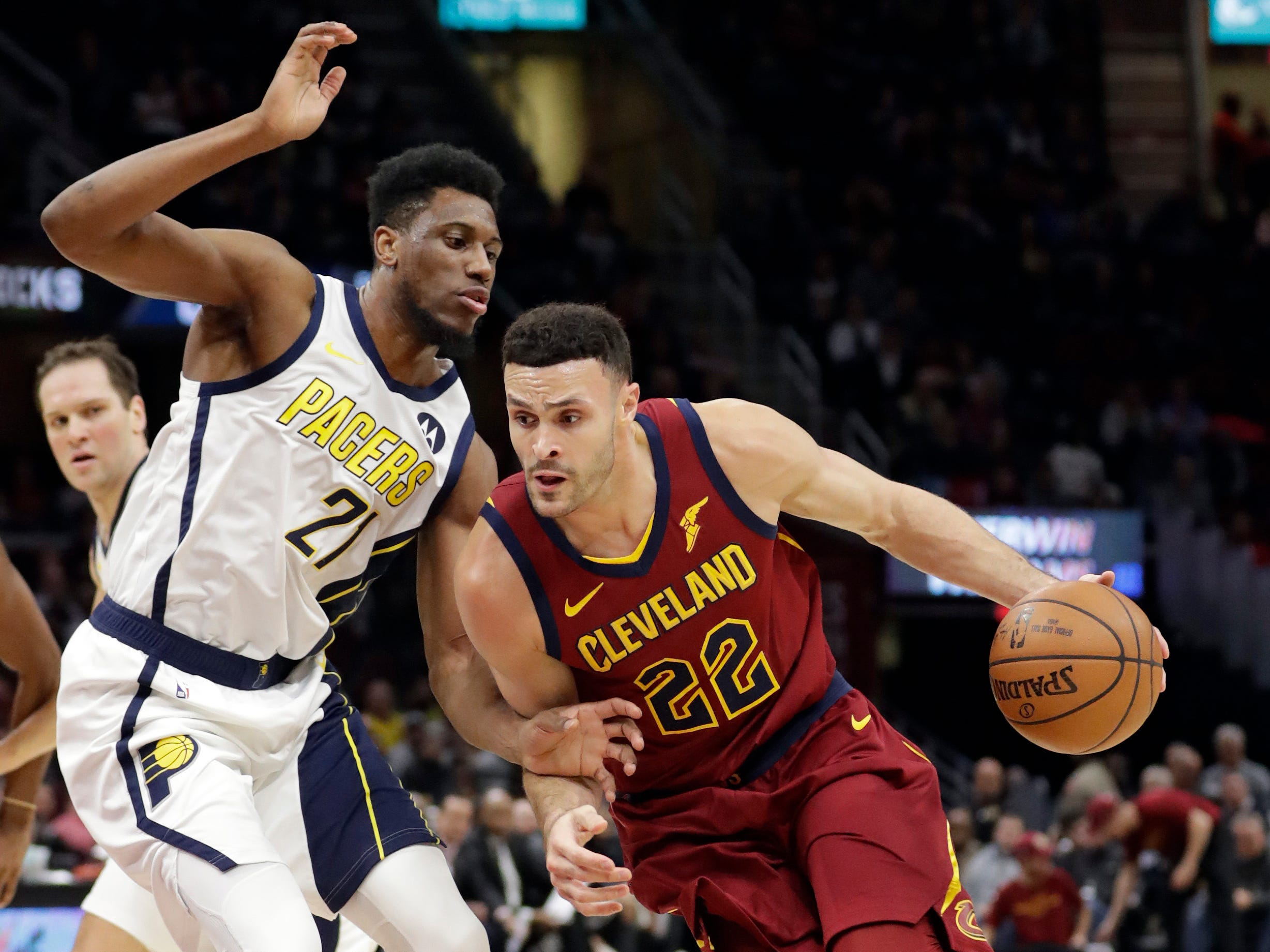 Cleveland Cavaliers' Larry Nance Jr. (22) drives to the basket against Indiana Pacers' Thaddeus Young (21) during the first half of an NBA basketball game Tuesday, Jan. 8, 2019, in Cleveland.