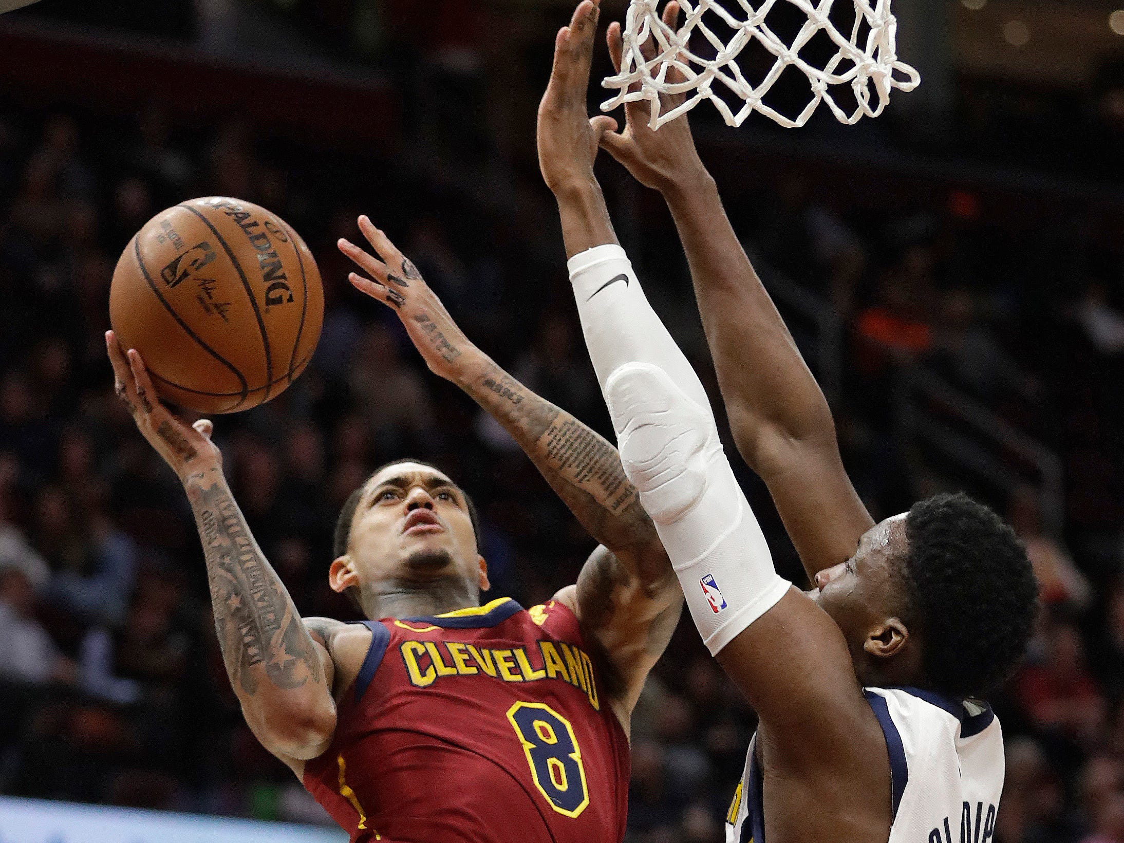 Cleveland Cavaliers' Jordan Clarkson (8) drives to the basket against Indiana Pacers' Victor Oladipo (4) during the first half of an NBA basketball game, Tuesday, Jan. 8, 2019, in Cleveland.