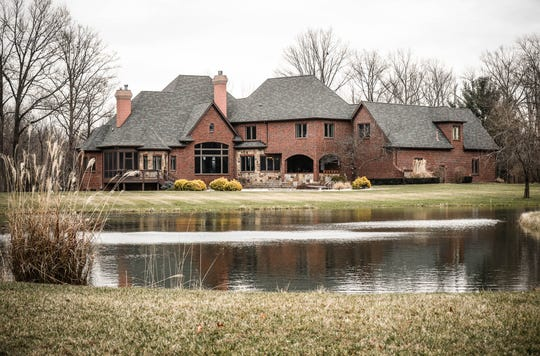 A stocked fish pond sits behind a traditional style $2m home up for sale in Bargersville Ind. on Wednesday, Jan. 9, 2019. The house sits on 8.1 acres.
