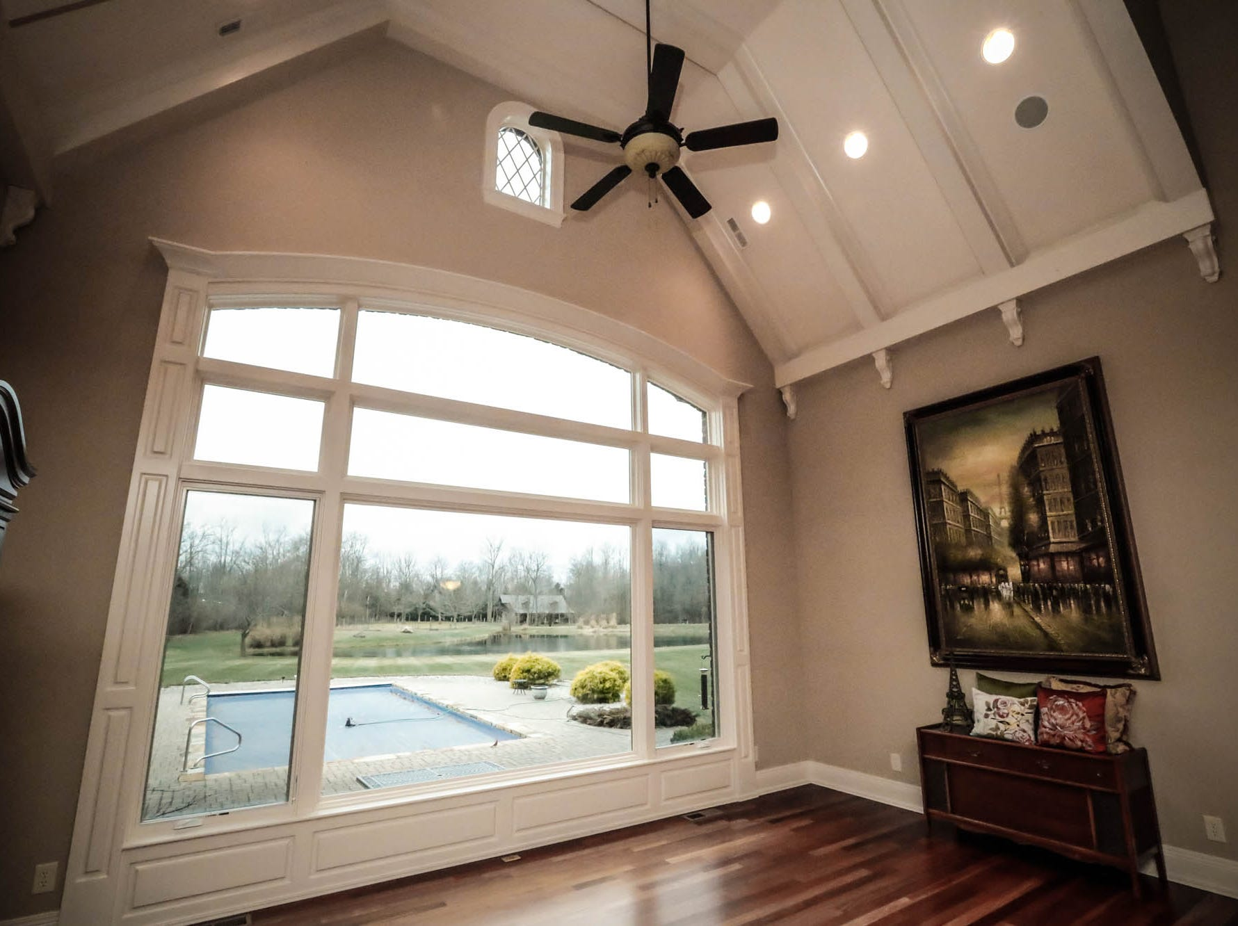A large picture window overlooks an in-ground pool in a traditional $2m home with elements of French country and Tuscan influence up for sale in Bargersville Ind. on Wednesday, Jan. 9, 2019. The house sits on 8.1 acres.