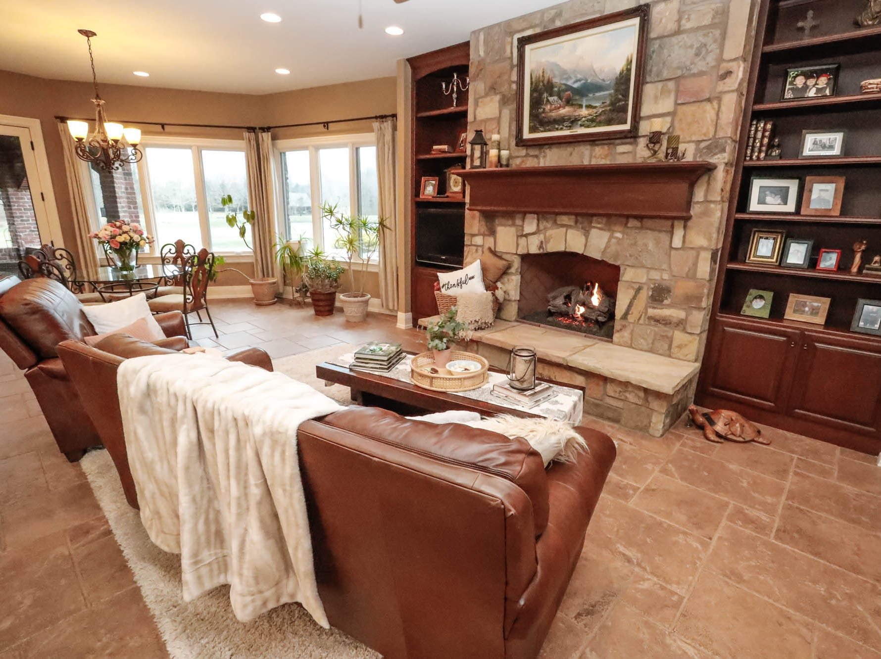 The open plan kitchen features a living room space with fireplace in a traditional $2m home up for sale in Bargersville Ind. on Wednesday, Jan. 9, 2019. The house sits on 8.1 acres.