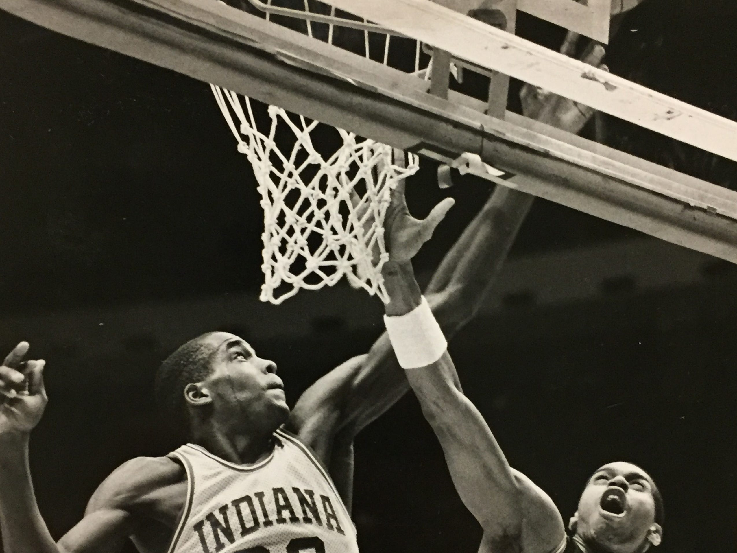 Dean Garrett blocks Troy Lewis' shot on Jan. 30, 1988.