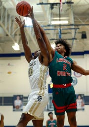 Lawrence North's Vincent Brady (2) and Decatur Central's Kenny Tracy (10) fight for a rebound in the first half of the Marion County tournament on Tuesday.