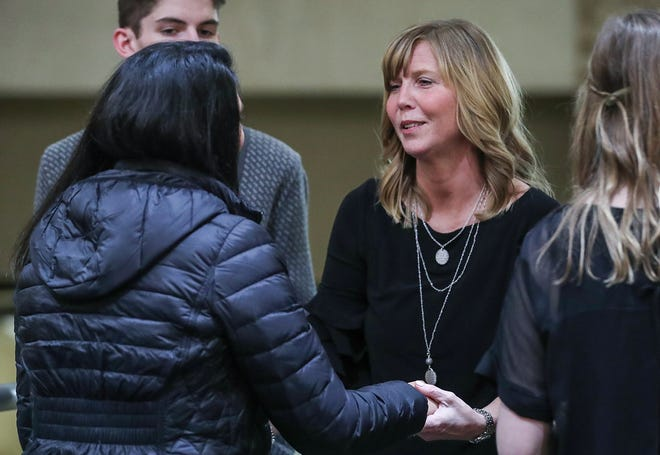 Tyler Trent's mother Kelly speaks with a well-wisher after the funeral for her son, a Purdue student and superfan, at College Park Church in Indianapolis, Tuesday, Jan. 8, 2019. The 20-year-old died of a rare form of bone cancer on Jan. 1, 2019.