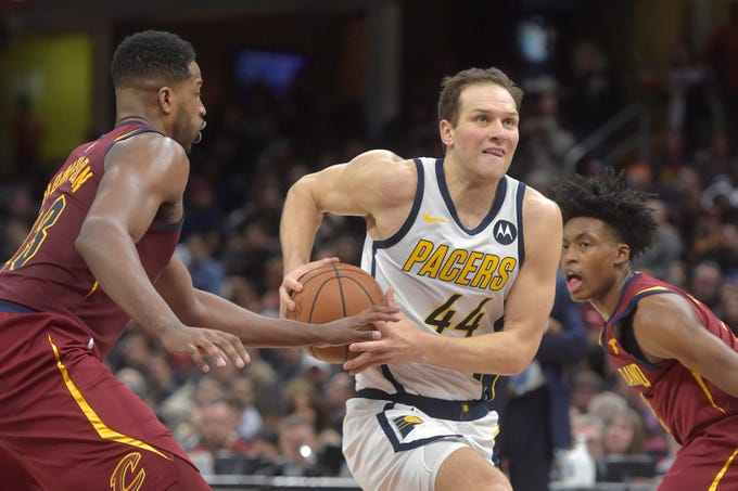 Jan 8, 2019; Cleveland, OH, USA; Indiana Pacers forward Bojan Bogdanovic (44) drives between Cleveland Cavaliers center Tristan Thompson (13) and guard Collin Sexton (right) in the second quarter at Quicken Loans Arena. Mandatory Credit: David Richard-USA TODAY Sports