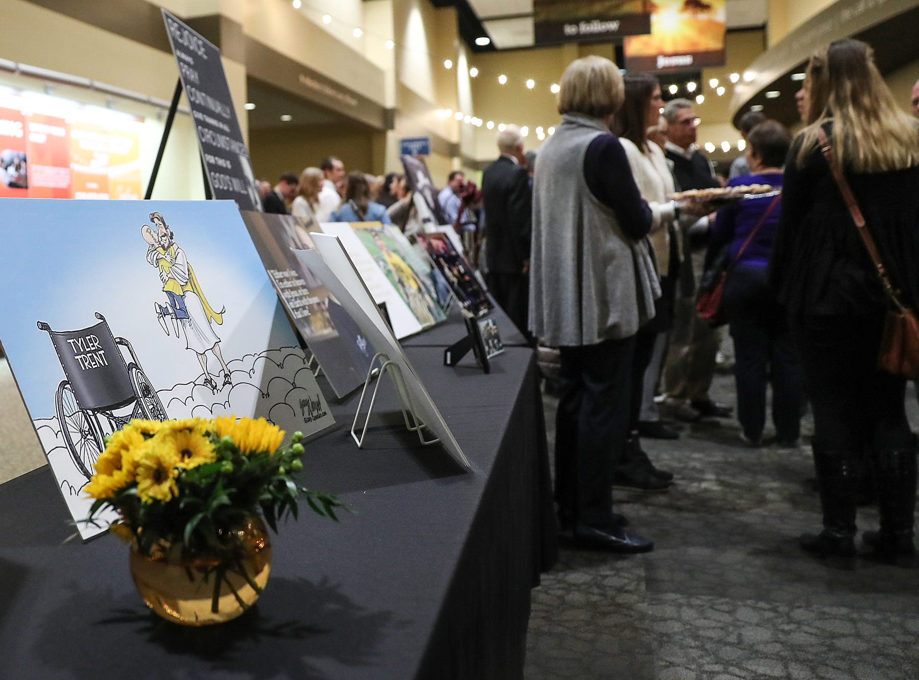 Pictures are displayed at the funeral for former Purdue student and superfan Tyler Trent at College Park Church in Indianapolis, Tuesday, Jan. 8, 2019. The 20-year-old died of a rare form of bone cancer on Jan. 1, 2019.