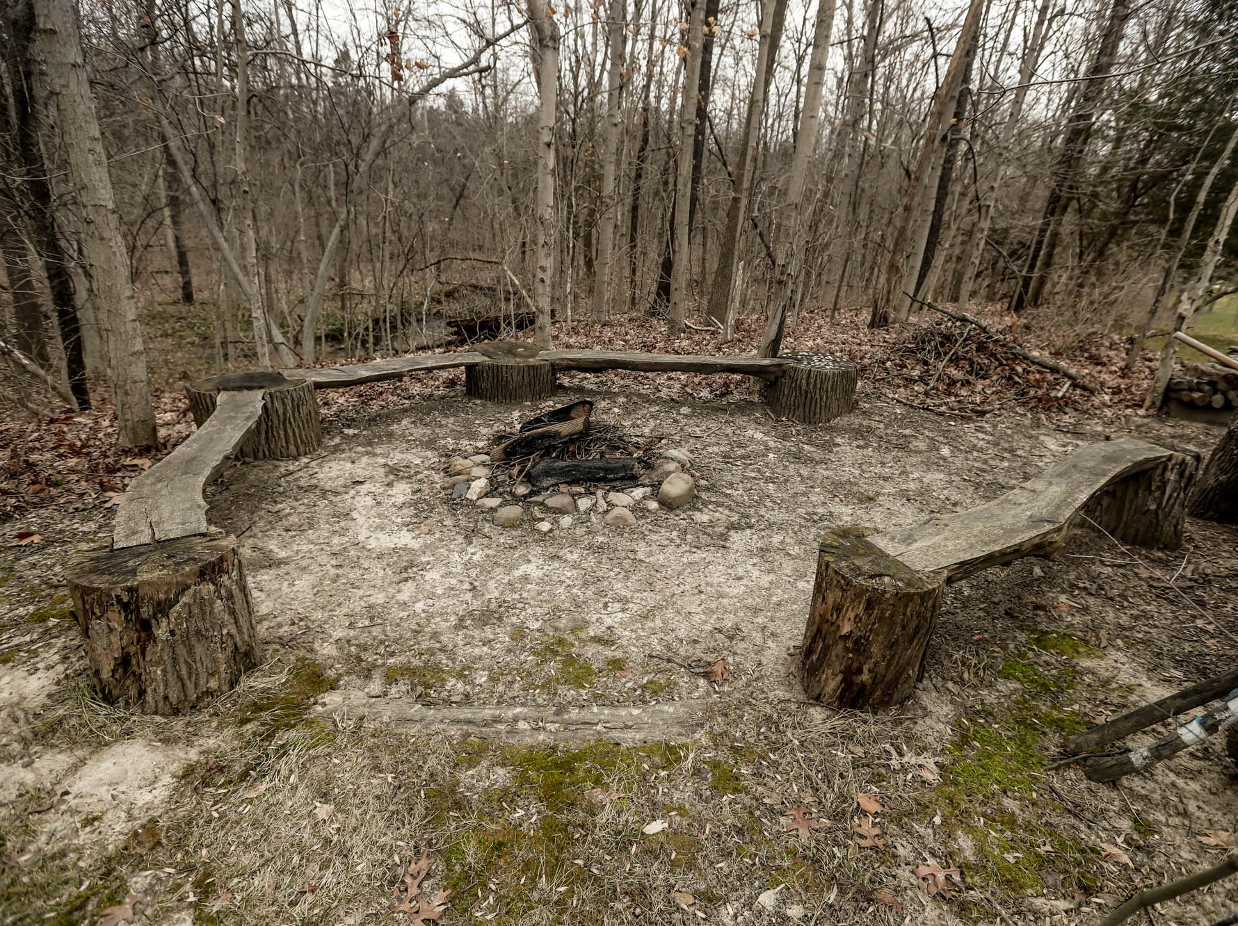 A rustic hand built fire pit is located outside a traditional style $2m home with elements of French country and Tuscan influence up for sale in Bargersville Ind. on Wednesday, Jan. 9, 2019. The house sits on 8.1 acres.