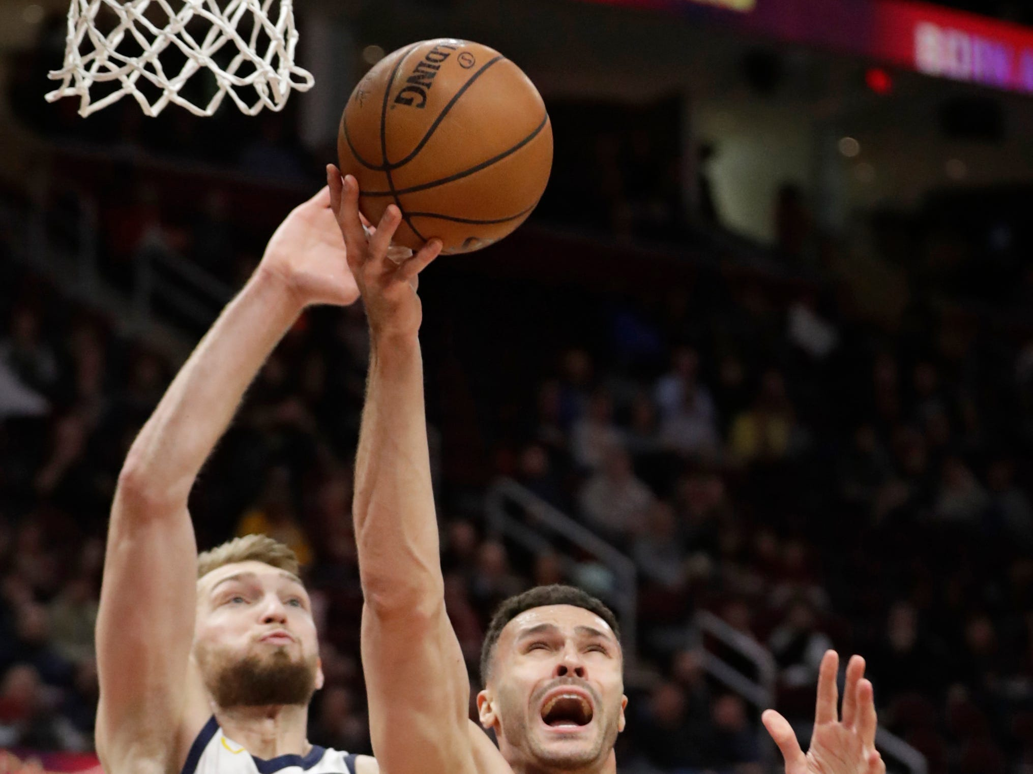 Cleveland Cavaliers' Larry Nance Jr. (22) is blocked by Indiana Pacers' Domantas Sabonis during the first half of an NBA basketball game Tuesday, Jan. 8, 2019, in Cleveland.
